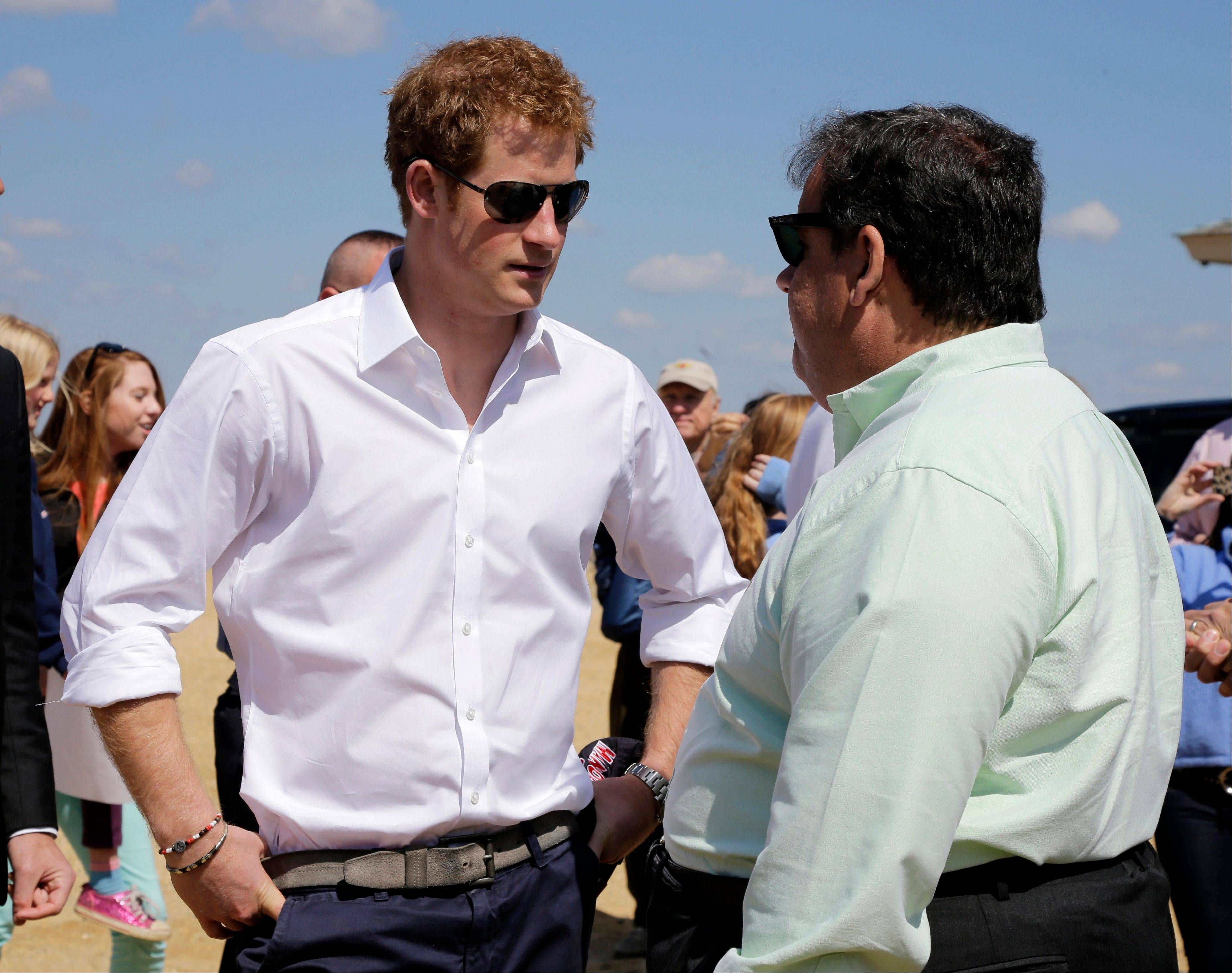 New Jersey Gov. Chris Christie talks to Britain's Prince Harry while visiting the area hit by Superstorm Sandy, Tuesday, May 14, 2013, in Seaside Heights, N.J. Prince Harry began a tour of New Jersey's storm-damaged coastline, inspecting dune construction, walking past destroyed homes and shaking hands with police and other emergency workers. New Jersey sustained about $37 billion worth of damage from the storm.