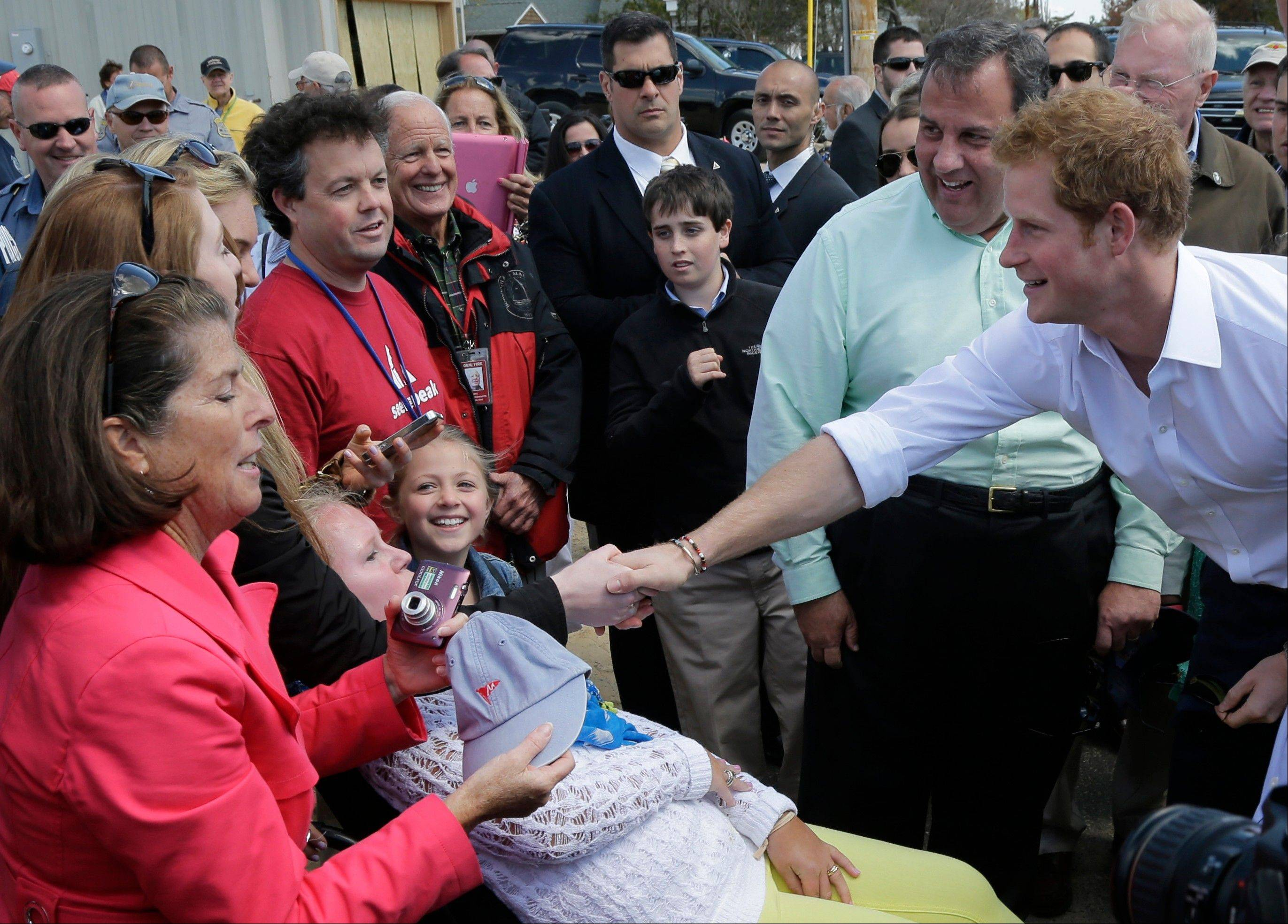 Britain's Prince Harry toured New Jersey's storm-damaged coastline, inspecting dune construction, walking past destroyed homes and shaking hands with police and other emergency workers. New Jersey sustained about $37 billion worth of damage from the storm.