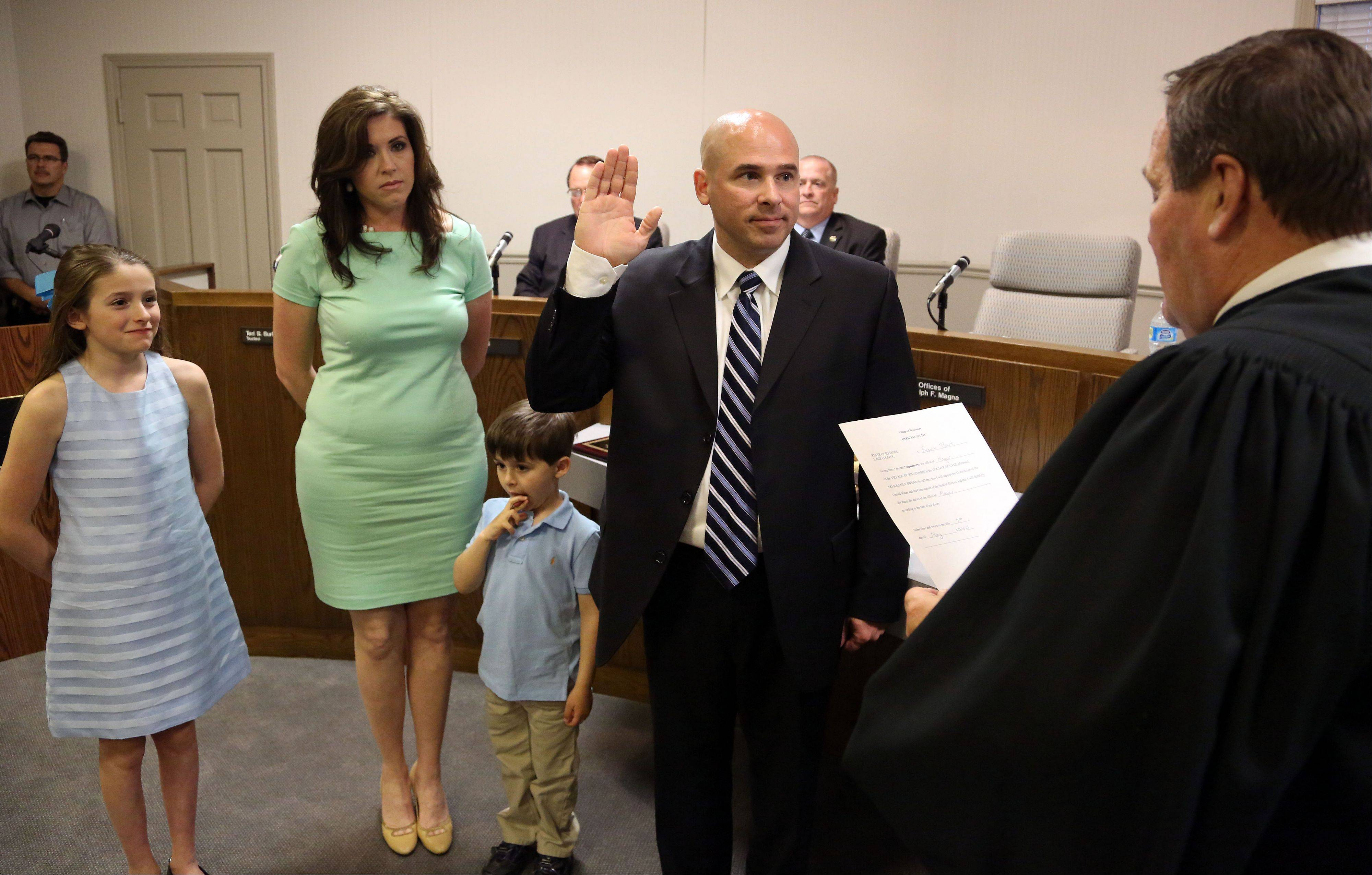 Frank Bart was sworn in last week the new mayor of Wauconda by retired Lake County Circuit Court Judge Henry Tonigan, right. Accompanying Bart were are his wife Christine and his children Anthony, 4, and Antonette, 10.