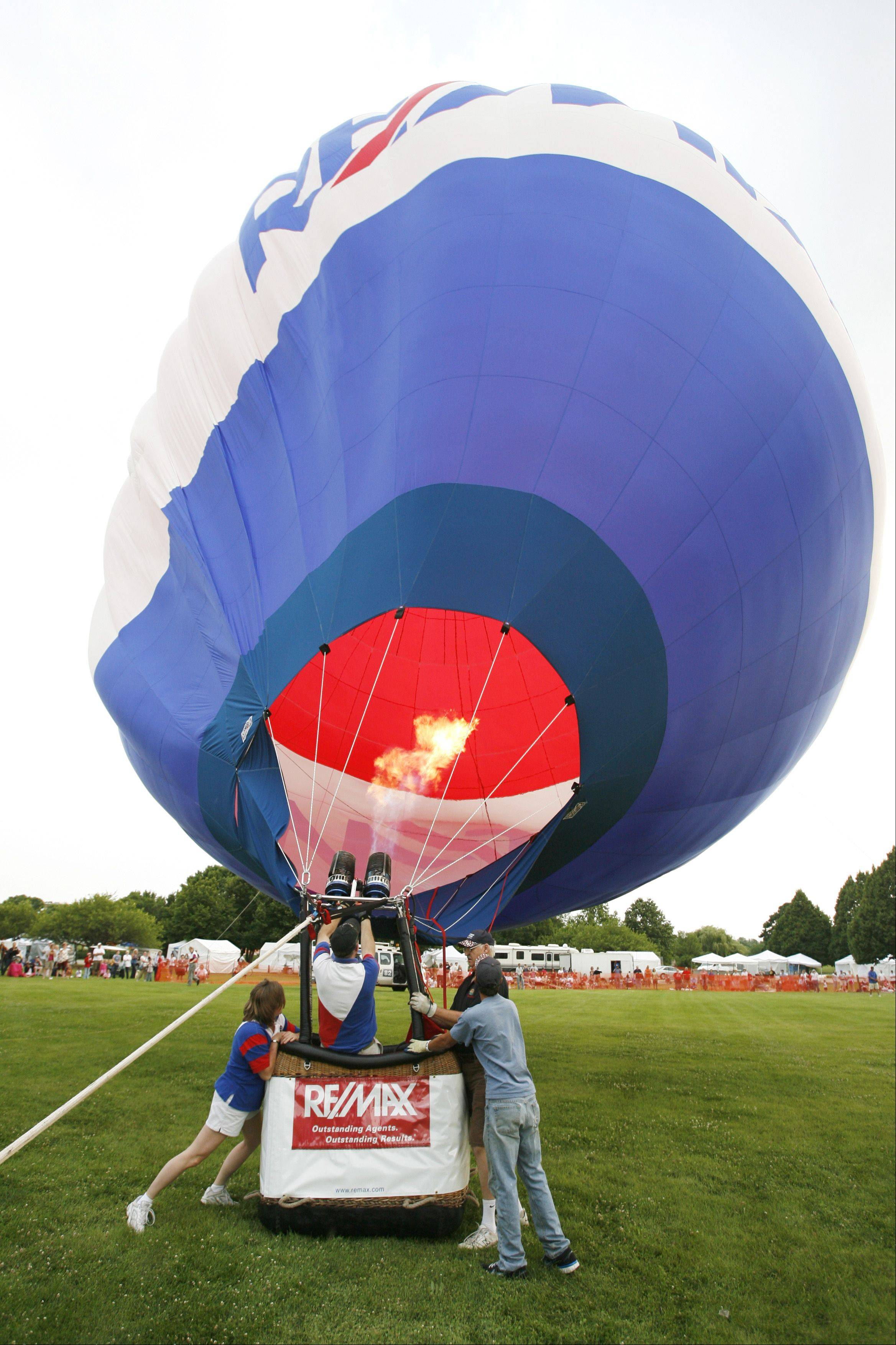 A one-day hot-air balloon festival is planned in Grayslake on Saturday, Aug. 24. The granddaddy of balloon events in the area is Lisle's Eyes to the Skies festival. This tethered balloon was at Eyes in the Skies in 2011.