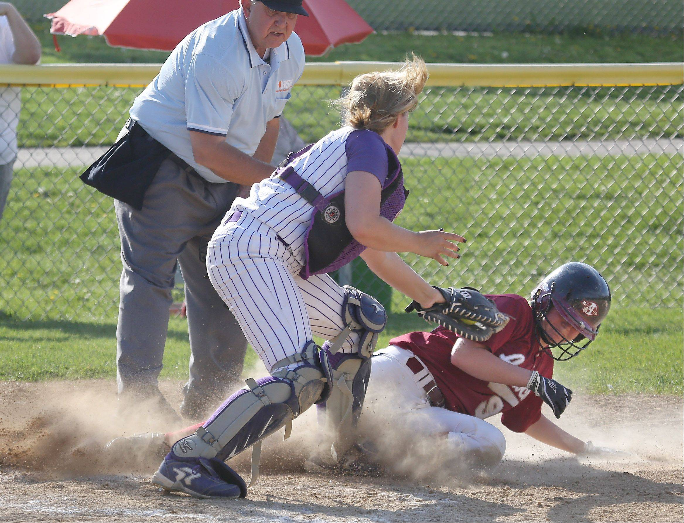Antioch runner Jessica Tyrell slides safely into home under the tag of Wauconda catcher Megan Luchowski at Wauconda on Tuesday.