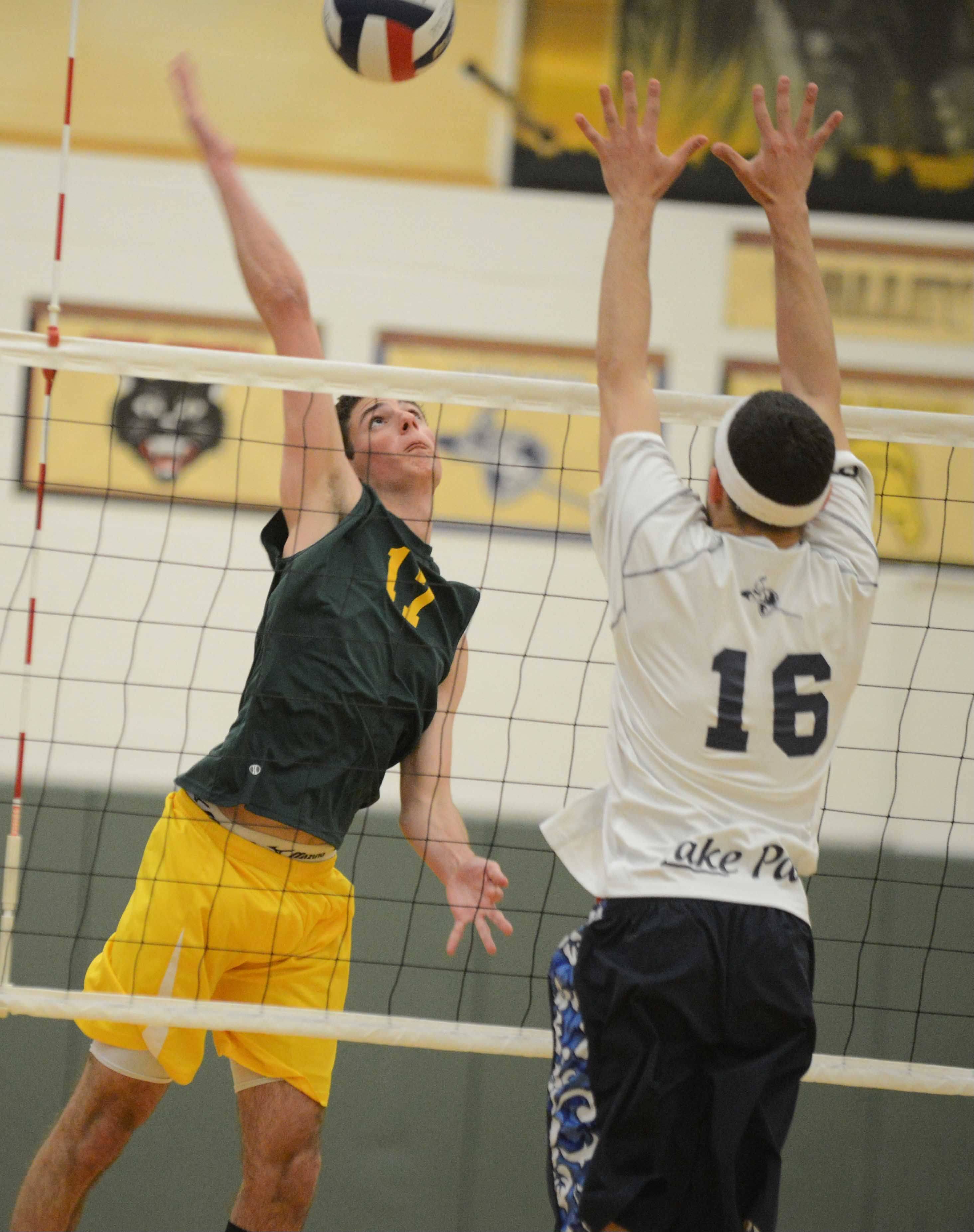 Michael Simmons of Waubonsie Valley hits one at Terry Dominick of Lake Park during the Lake Park at Waubonsie Valley boys volleyball game Tuesday.