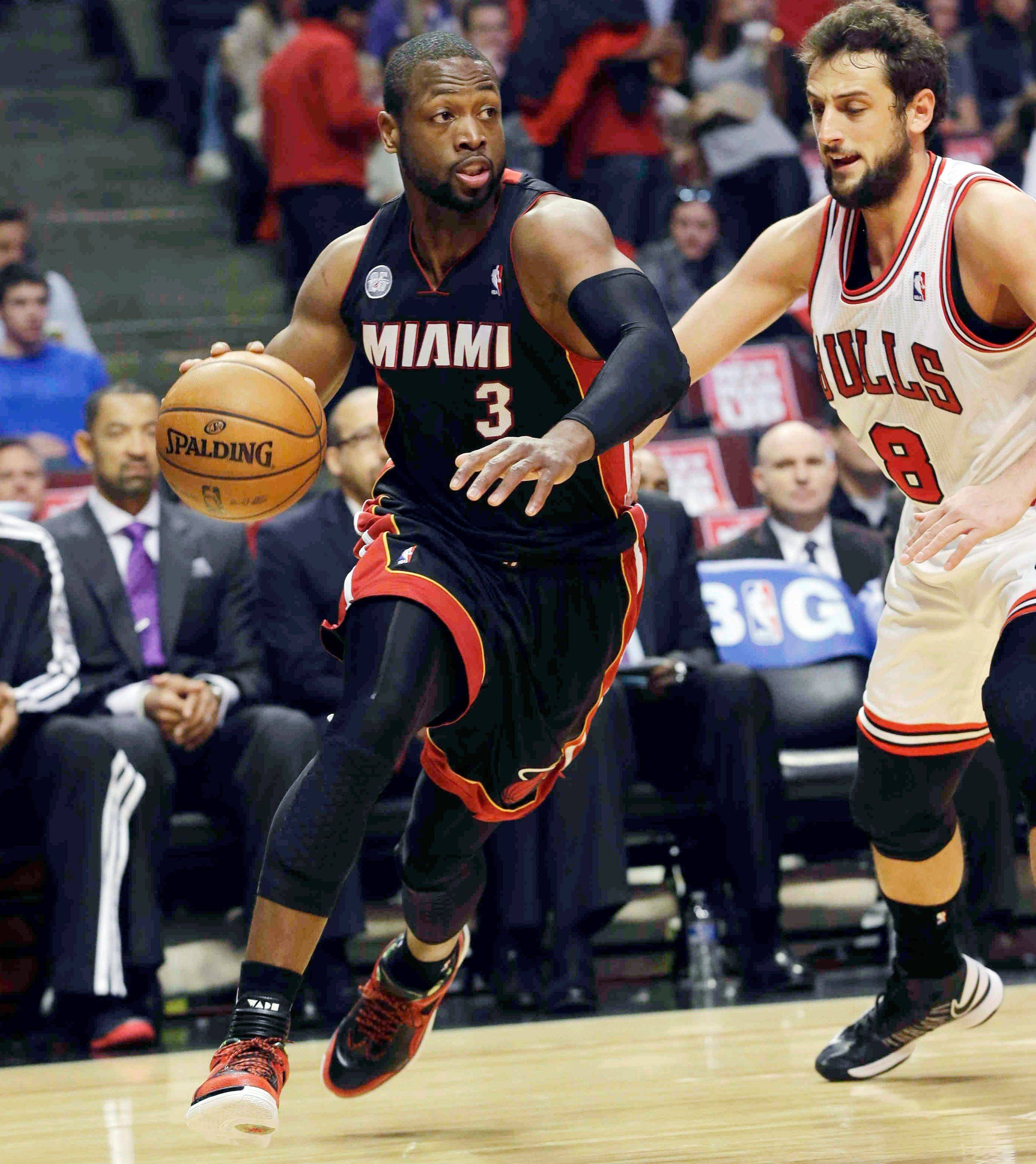 Dwyane Wade drives against Marco Belinelli (8) during the first half of Game 4 of the Eastern Conference semifinals. Wade has been battling bone bruises on his right knee for weeks and could sit out Game 5 tonight.
