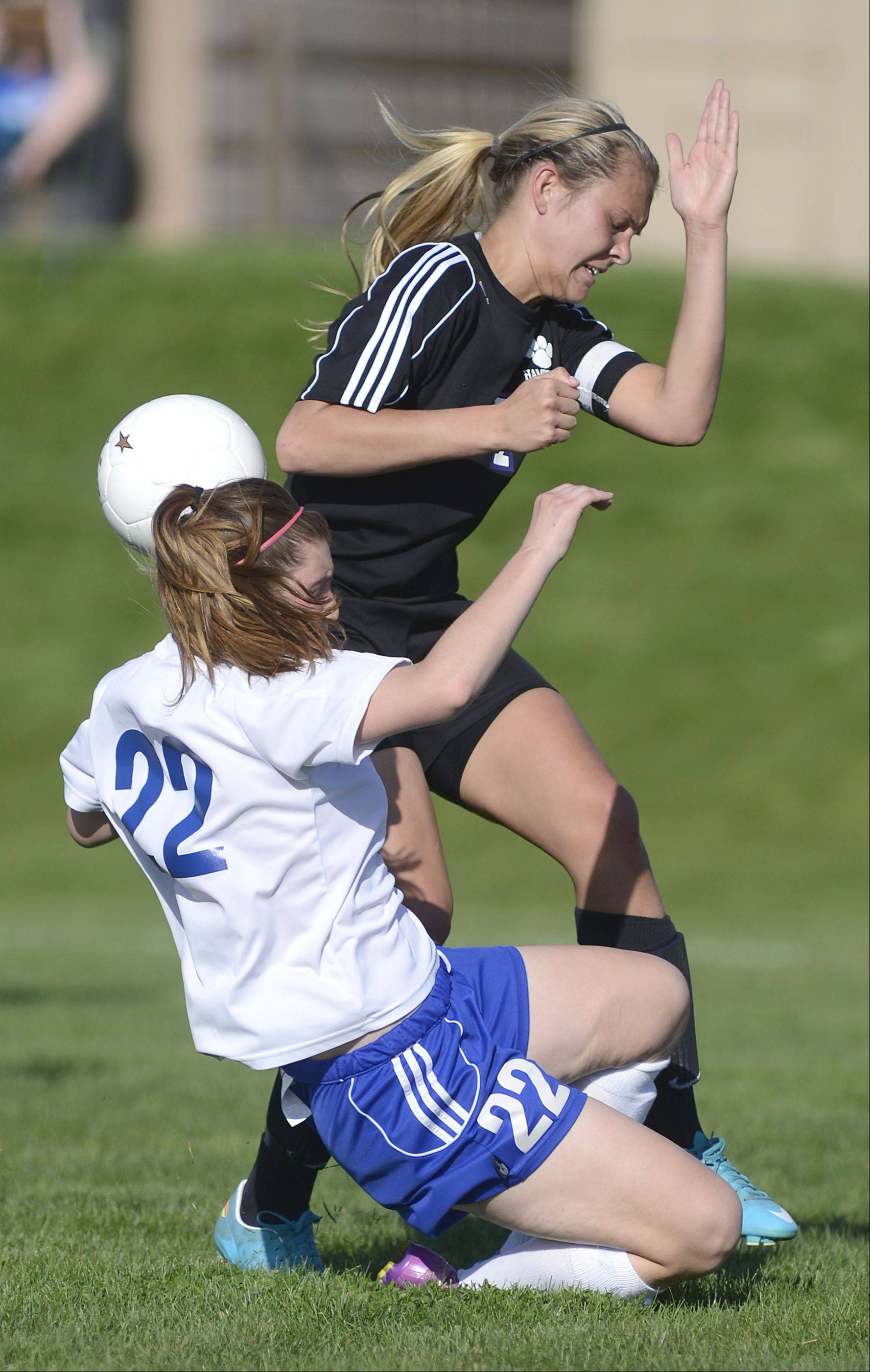 Burlington Central's Baily Panjkovich and Hampshire's Lizzie Panzica collide while battling for the ball in the second half of the Class 2A regional semifinal on Tuesday.