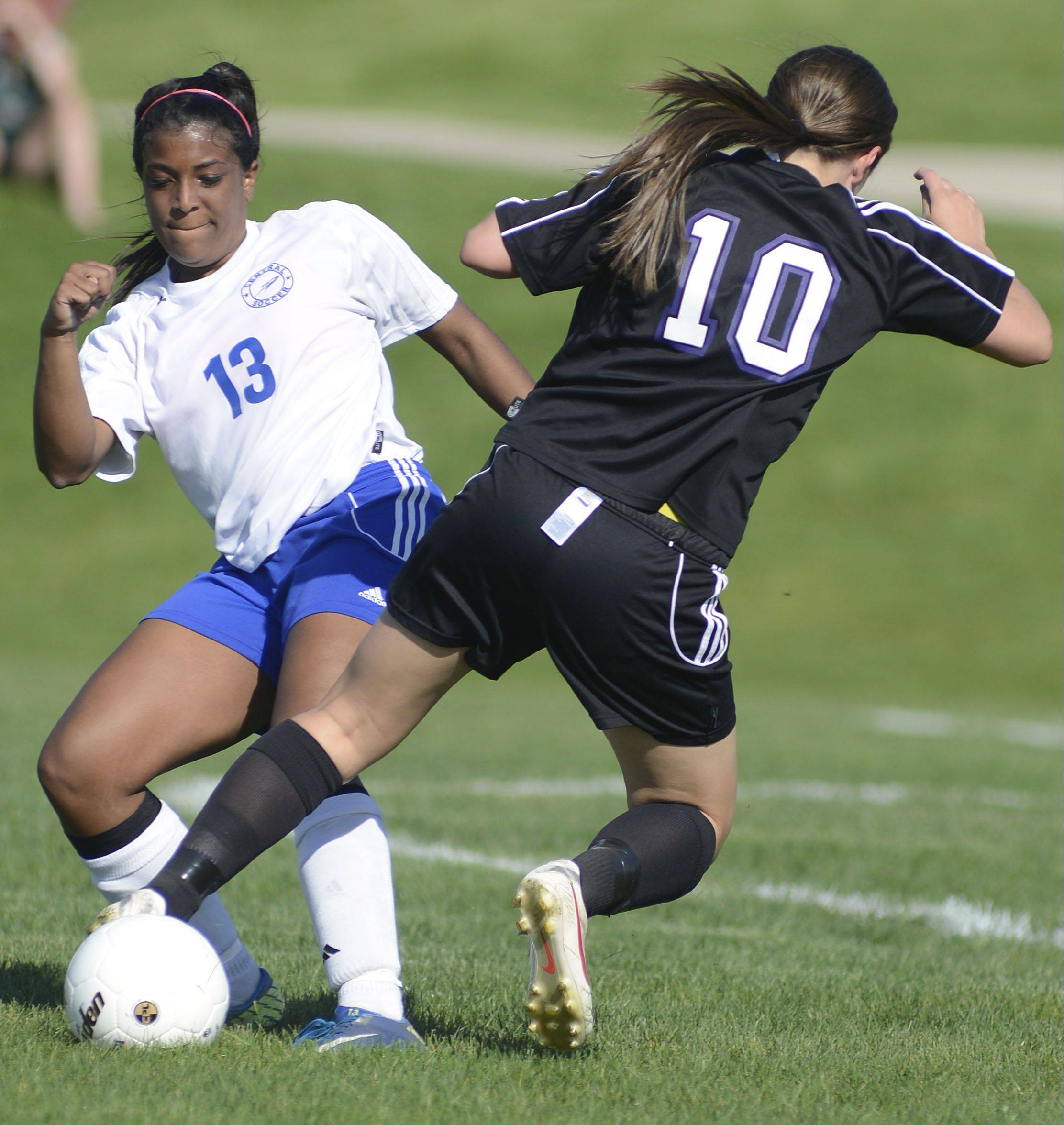 Burlington Central's Lexi Kern and Hampshire's Alex Zeller battle for the ball in the first half of the Class 2A regional semifinal on Tuesday.