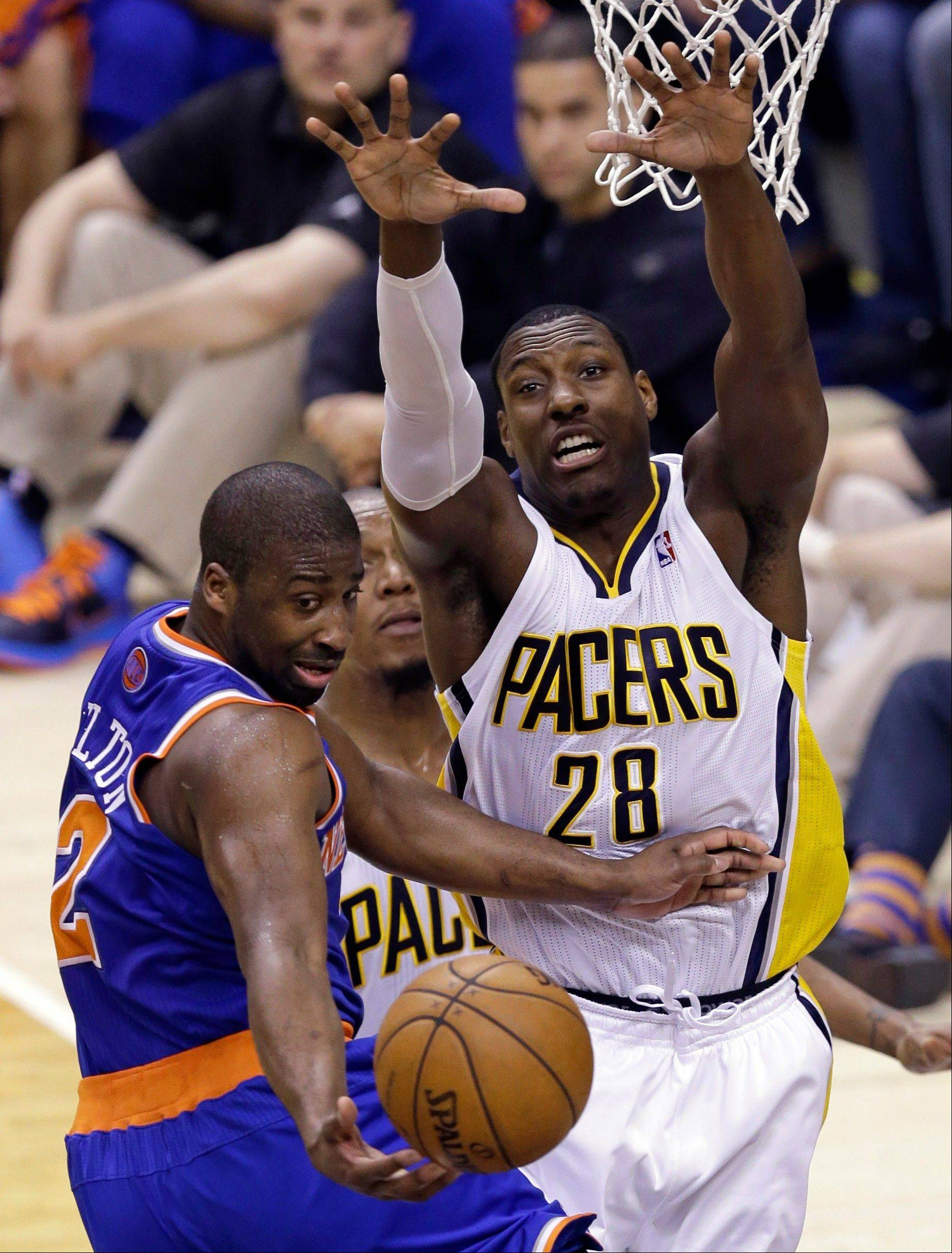Indiana Pacers center Ian Mahinmi (28) forces New York Knicks guard Raymond Felton to pass on a drive to the basket during the first half of Game 4 of the Eastern Conference semifinal NBA basketball playoff series, in Indianapolis on Tuesday, May 14, 2013.