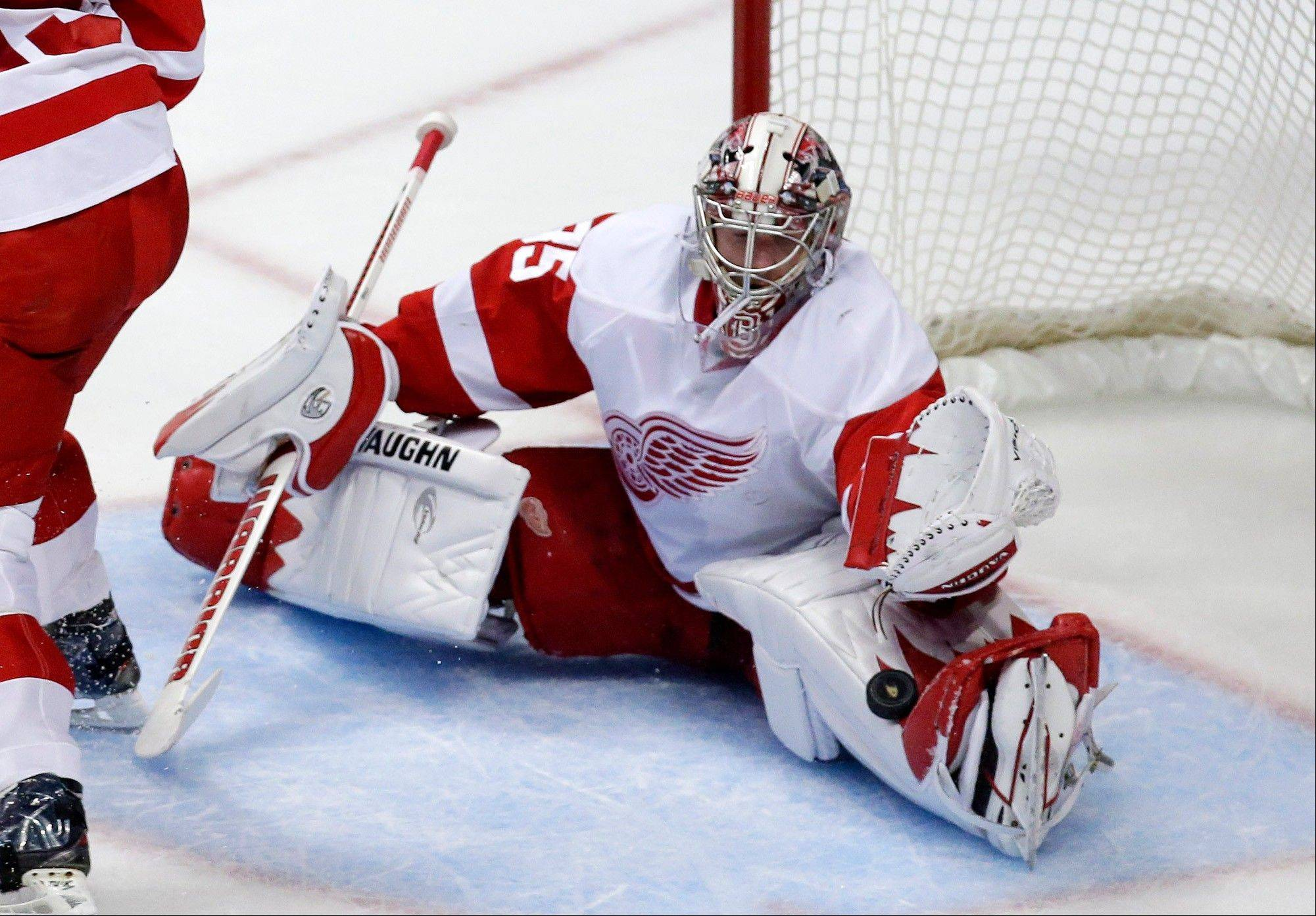 Detroit Red Wings goalie Jimmy Howard stops a shot during the first period in Game 7 of their first-round NHL hockey Stanley Cup playoff series against the Anaheim Ducks in Anaheim, Calif., Sunday, May 12, 2013.