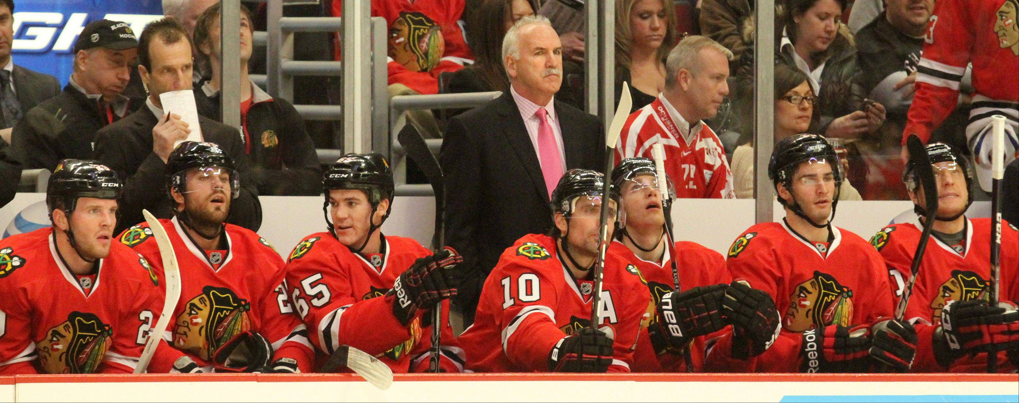 From his central position behind the bench, Blackhawks head coach Joel Quenneville has pushed all the right buttons for his record