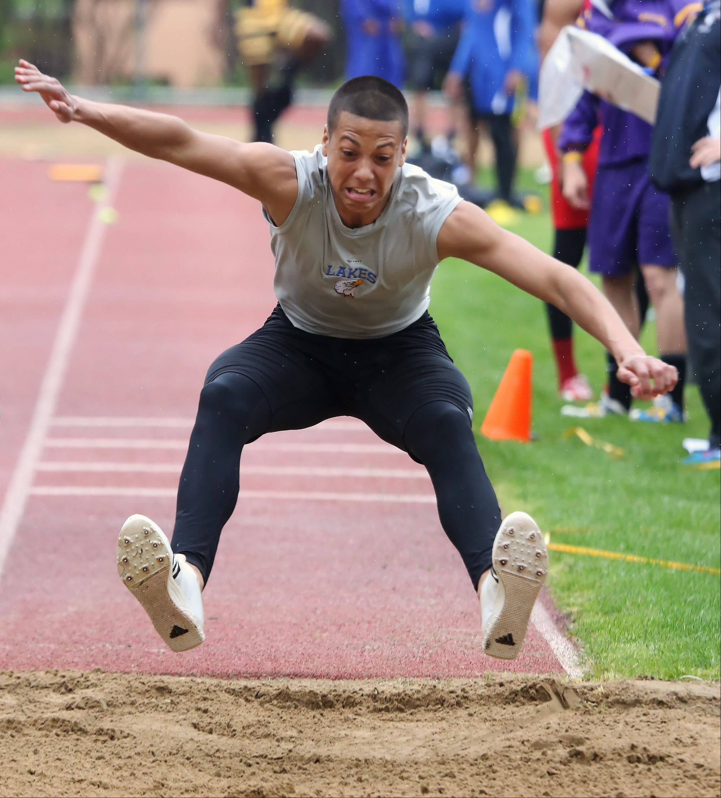 Lakes' Caleb Arnwine competes in the triple jump during the North Suburban Conference boys track meet Thursday in Libertyville.