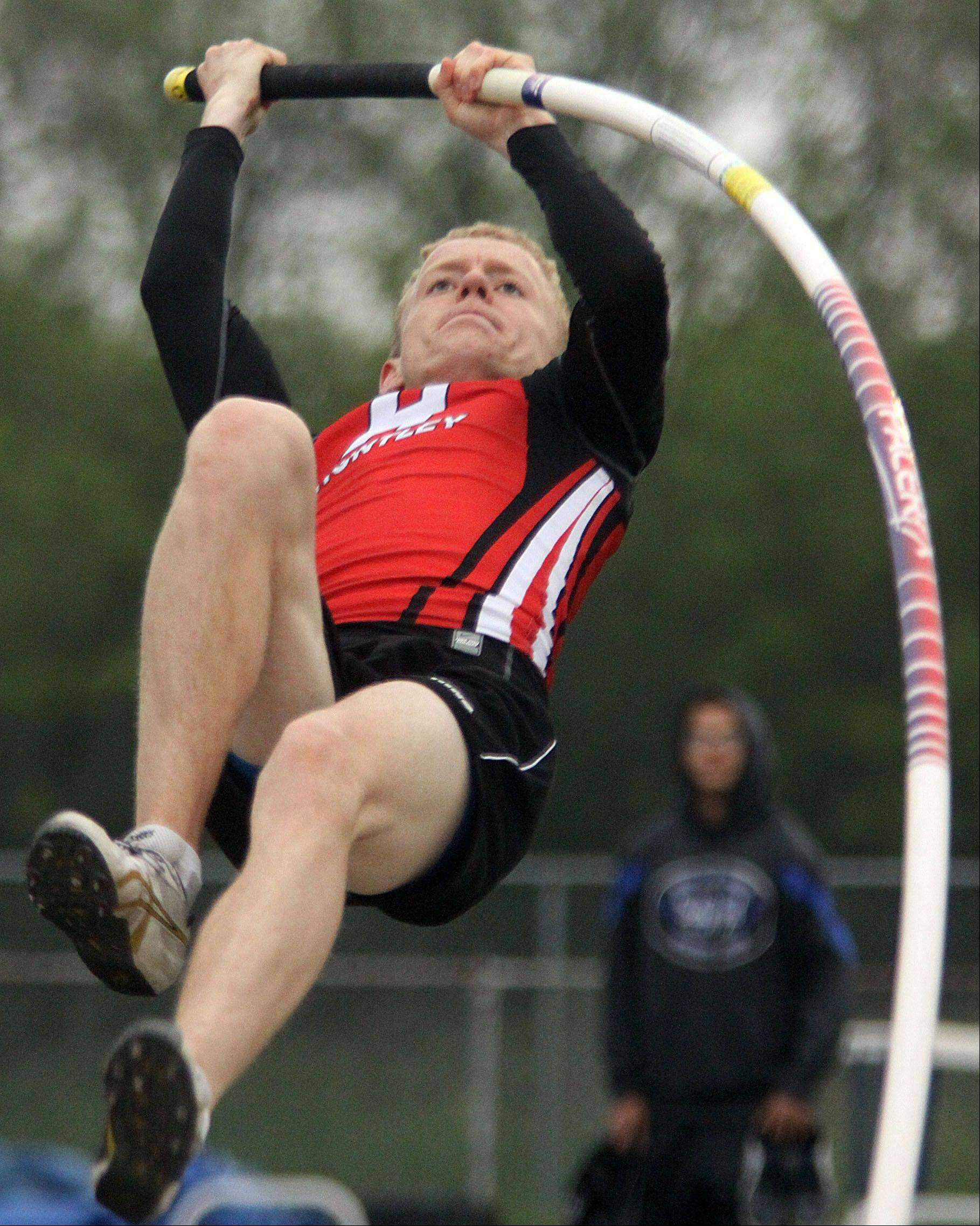 Huntley's Craig Lambert clears the bar in the pole vault event at Friday's Fox Valley Conference track meet in Cary.