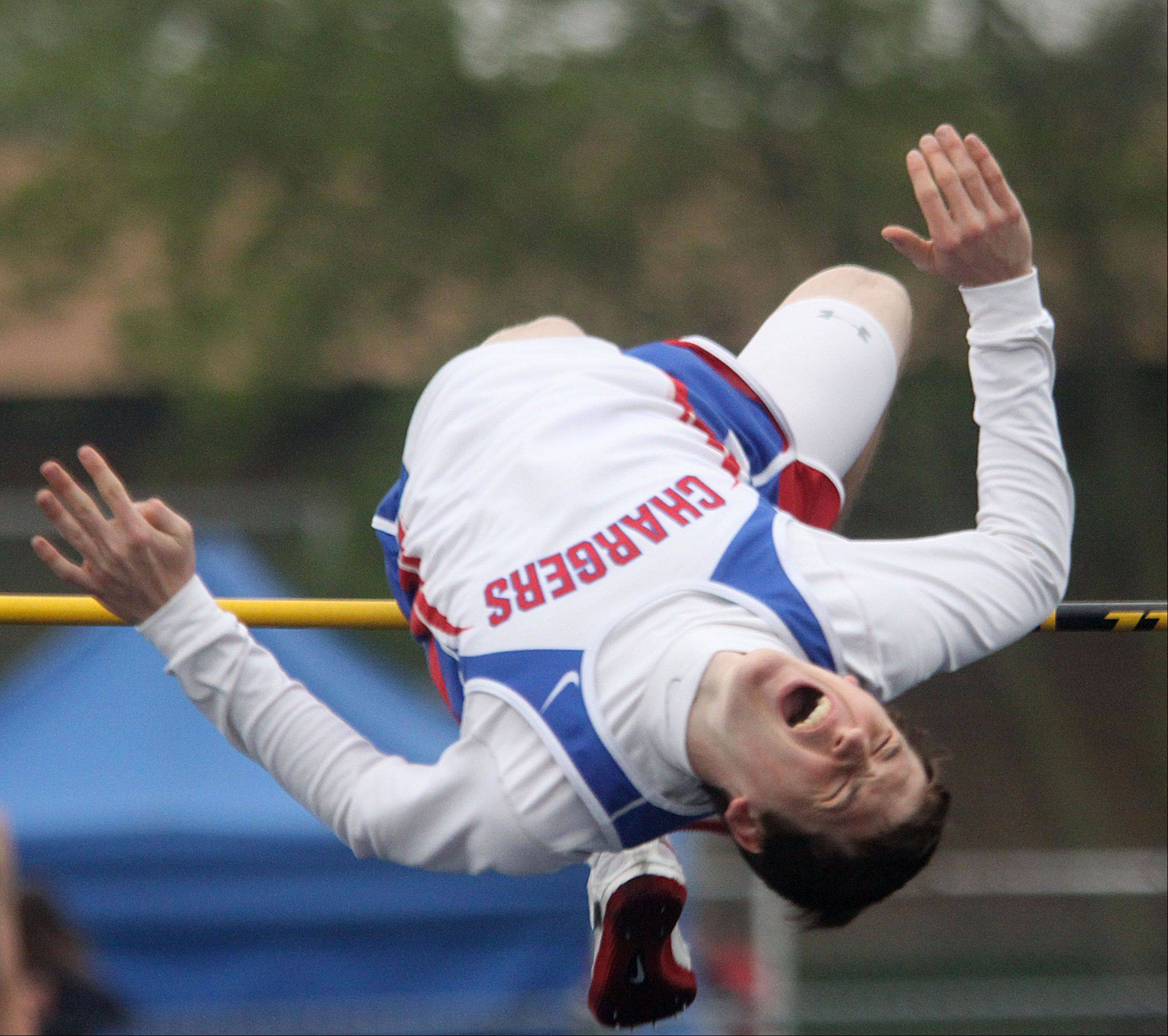 Dundee-Crown's Trevor Downing clears the bar in the high jump event at the Fox Valley Conference track meet Friday.