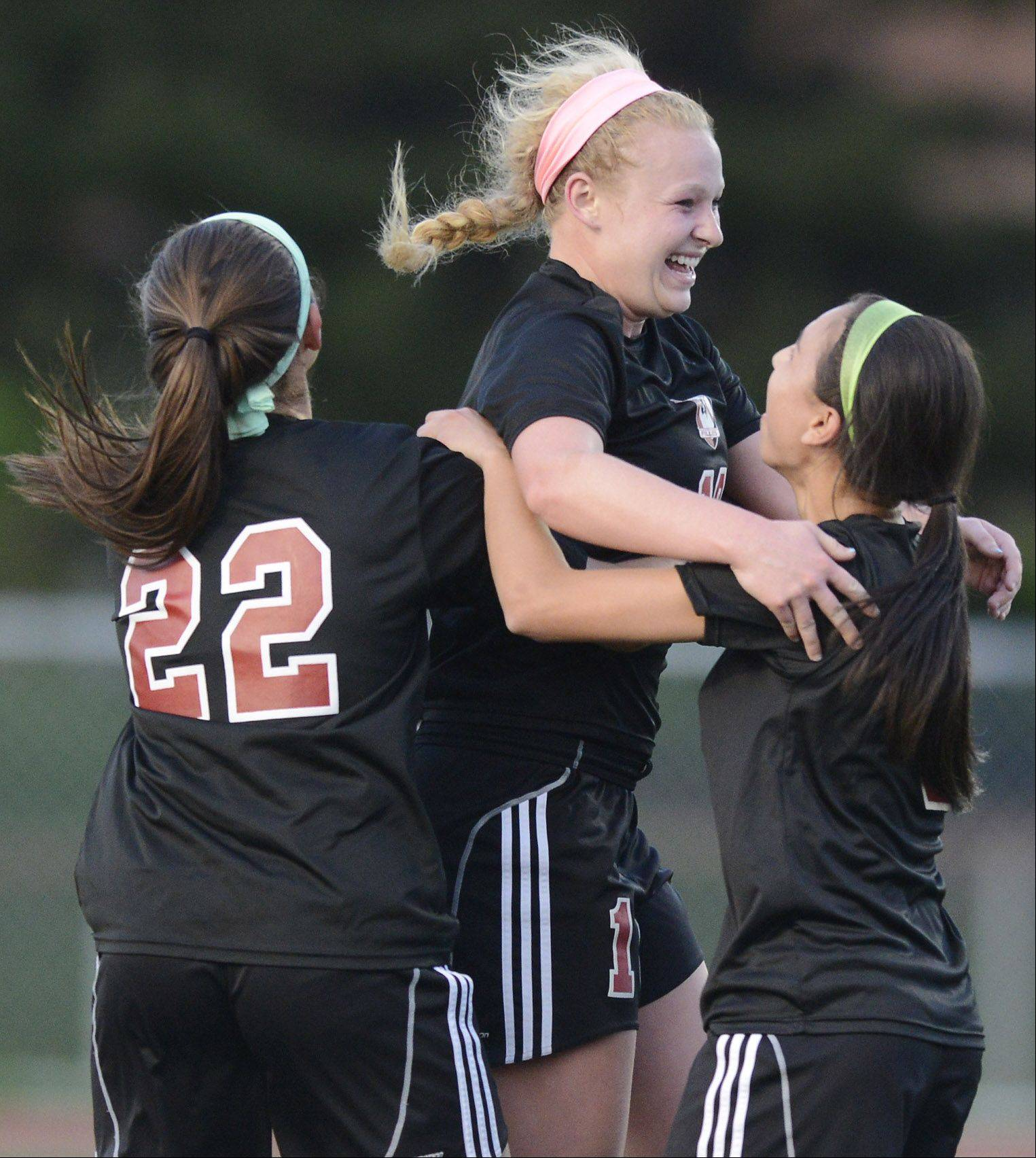 Barrington's Molly Pfeiffer, middle, celebrates her first-half goal with teammates Elli Ackerman, left, and Aimee Pierce during Wednesday's Mid-Suburban League championship game at Buffalo Grove.