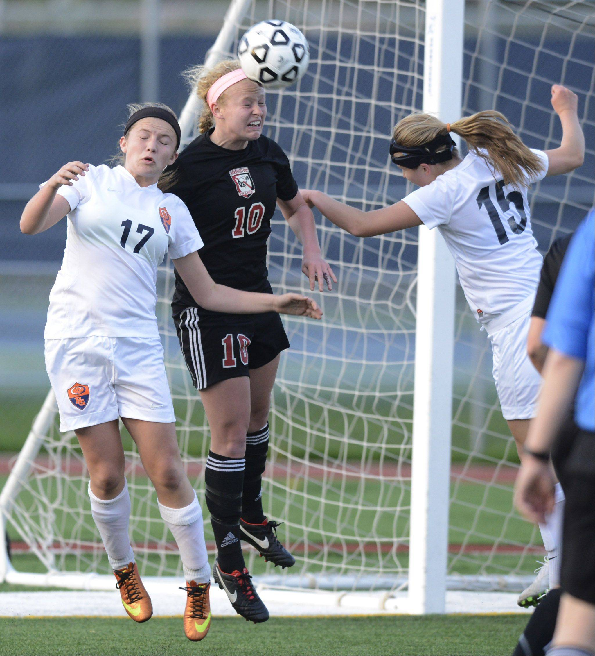 Barrington's Molly Pfeiffer, gets between Buffalo Grove's JayJay Lowery, left, and Kelly VandeMerkt for a header during Wednesday's Mid-Suburban League championship game at Buffalo Grove.