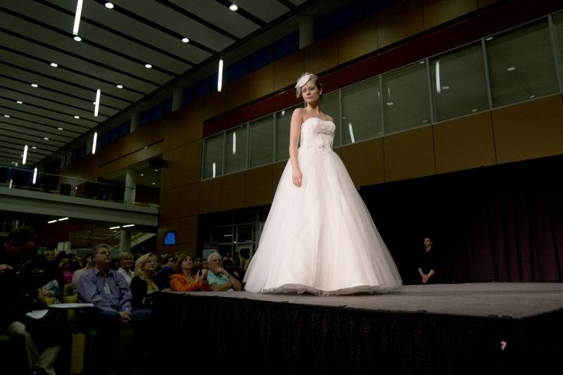 "A model shows off a wedding dress created by Anna Loosli (Carol Stream) during ""Sketches,"" the annual College of DuPage Fashion Show"