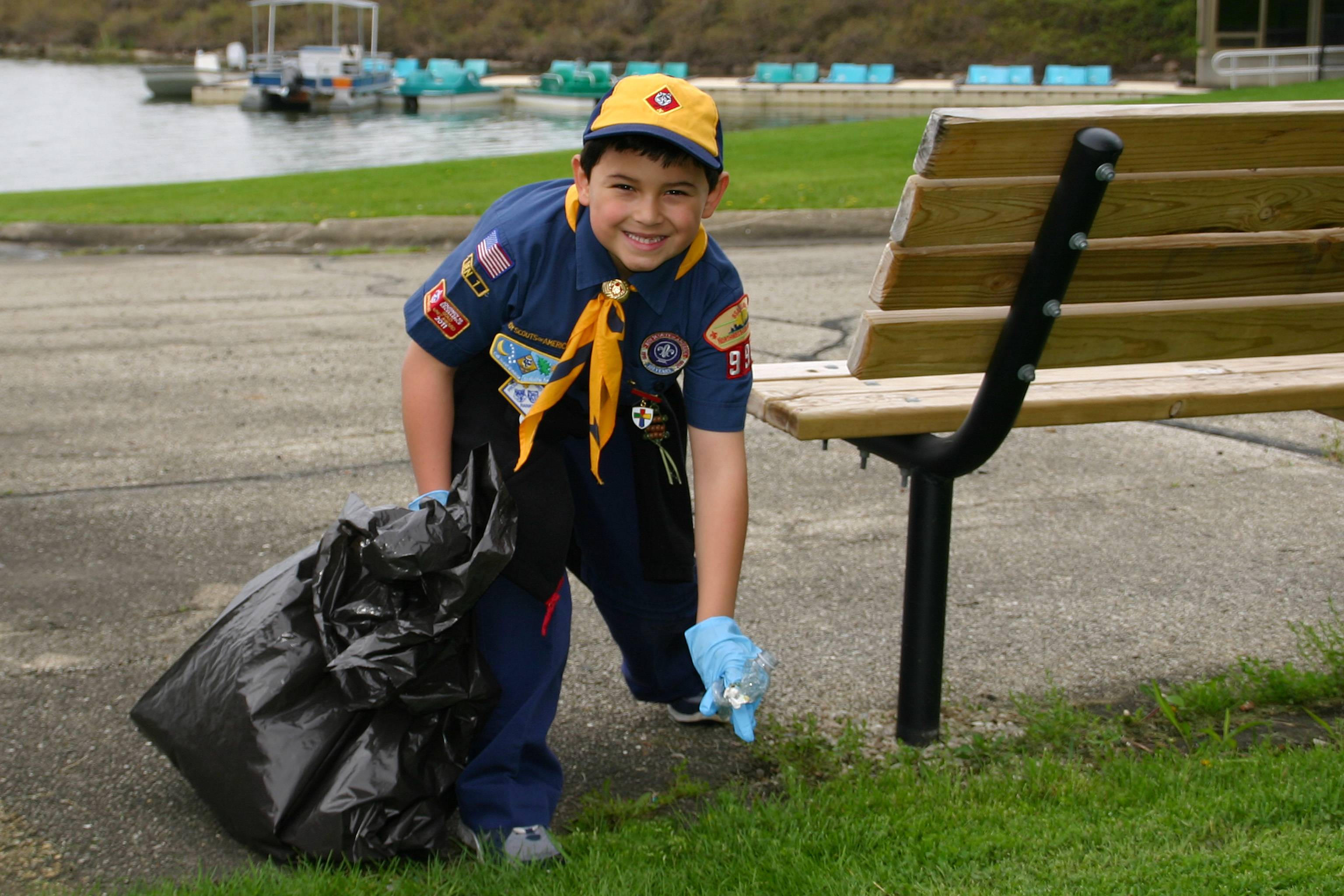 Dorian Michael Schrader, 7, from Cub Scout Pack 997, at Iroquois Community School, picks up trash at Lake Park on Park Clean Up Day, May 11.