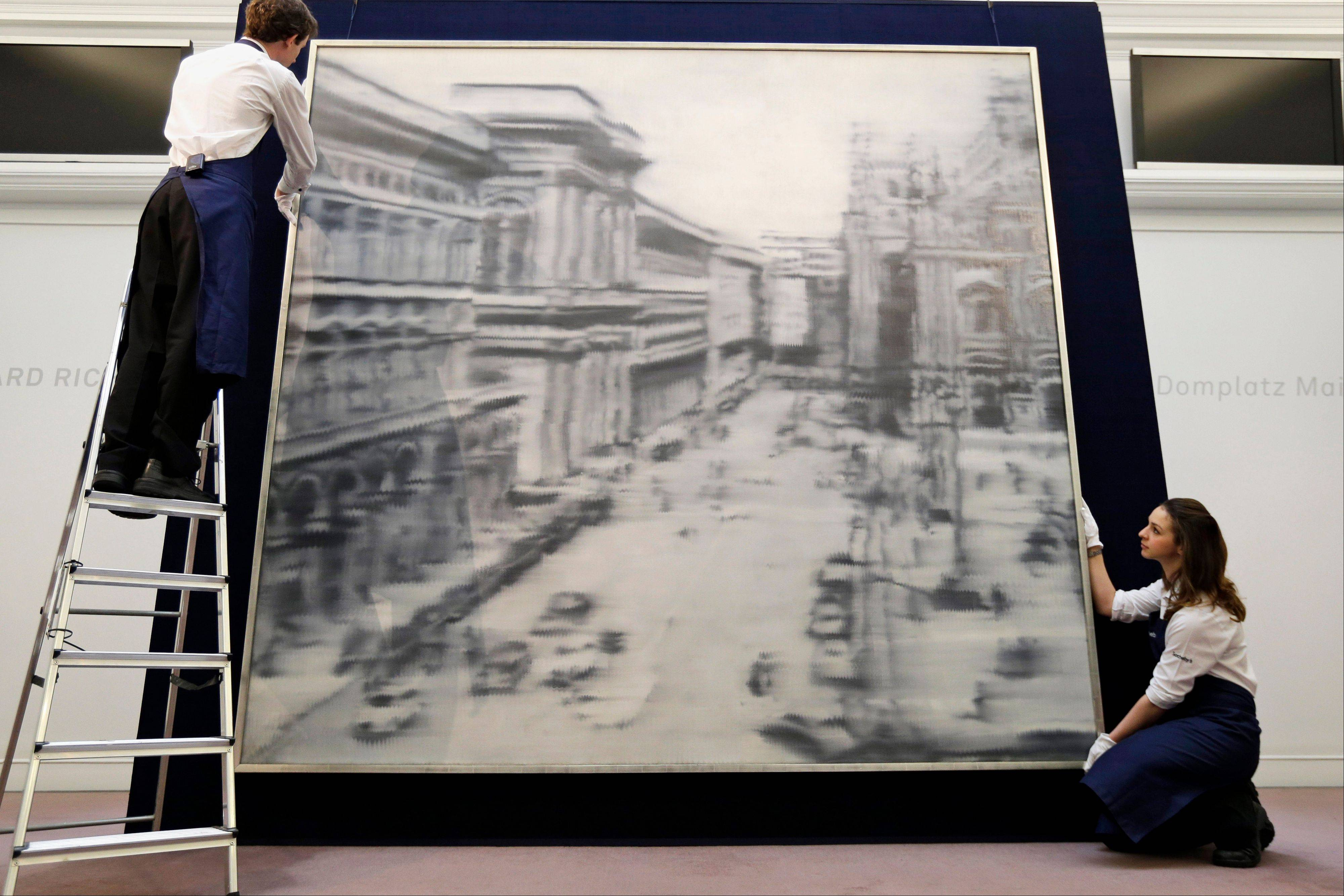 Sotheby�s employees with Gerhard Richter�s 1968 oil on canvas painting �Domplatz, Mailand� in London.