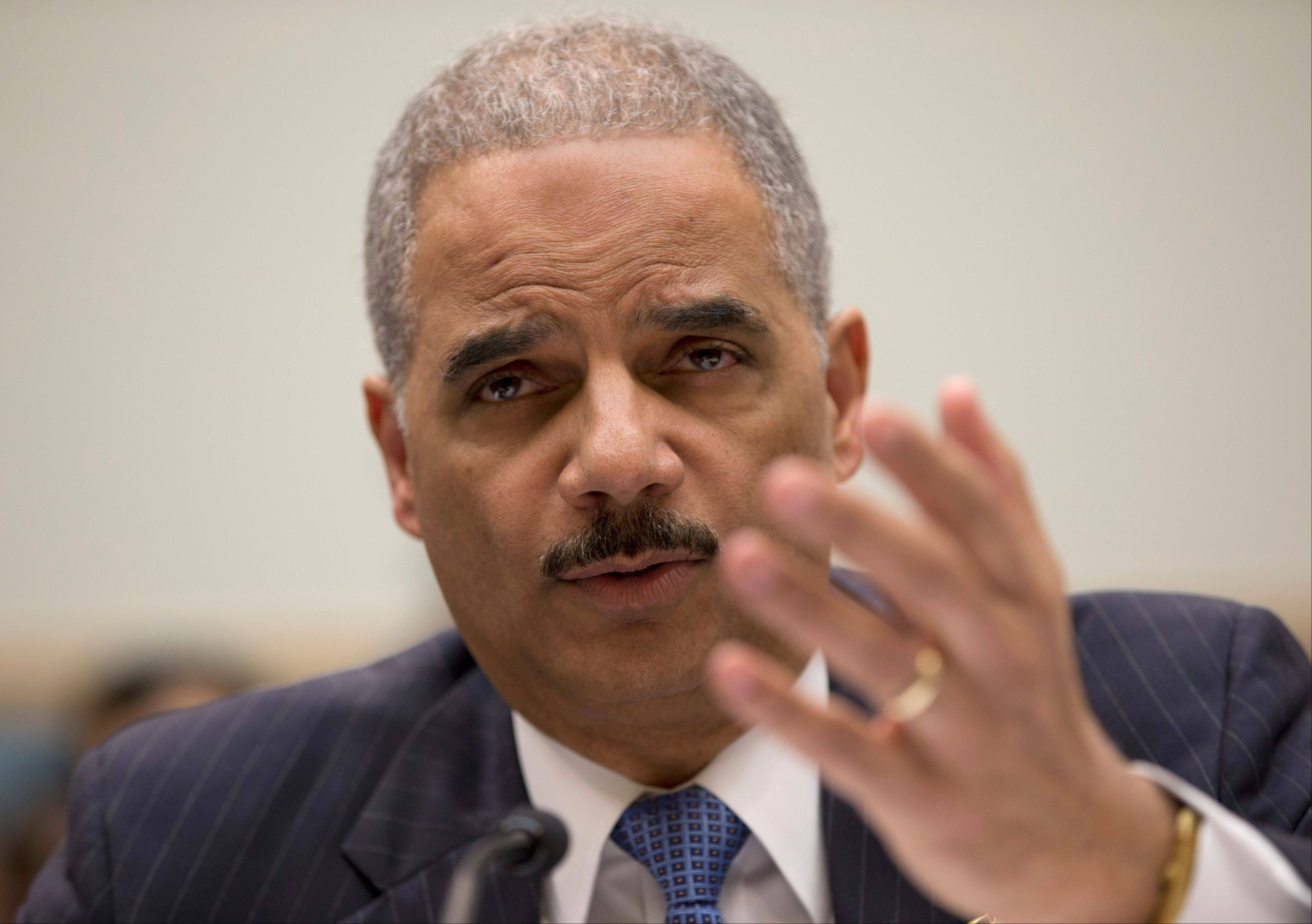Attorney General Eric Holder testifies on Capitol Hill in Washington Wednesday before the House Judiciary Committee oversight hearing on the Justice Department.