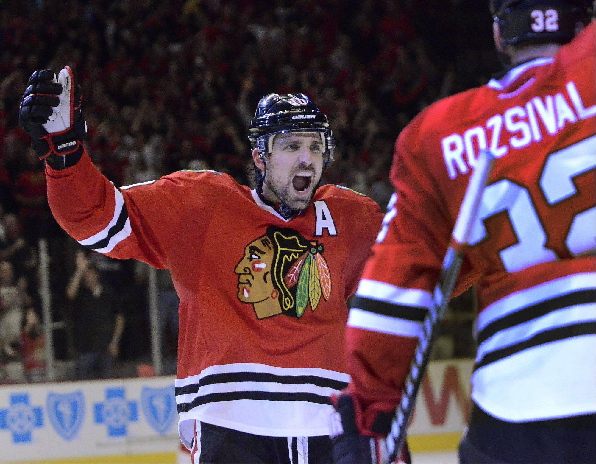 Patrick Sharp celebrates after assisting on Johnny Oduya's goal in the 3rd period during game 1 of Western Conference semifinals between the Chicago Blackhawks and the Detroit Red Wings. Sharp was also 1st star of the game.