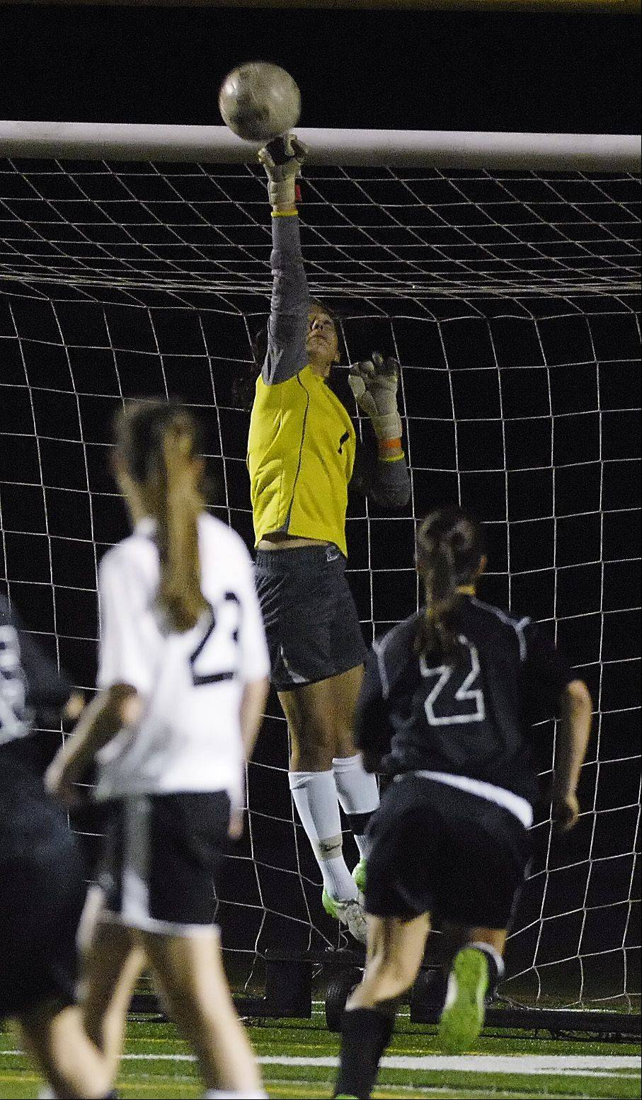 Goalie Abigail Fuster of Wheaton Warrenville South blocks a shot on goal in the final seconds of her teams 1-0 win over Glenbard West, in the girls soccer Class 3A York regional semifinals, Wednesday night.
