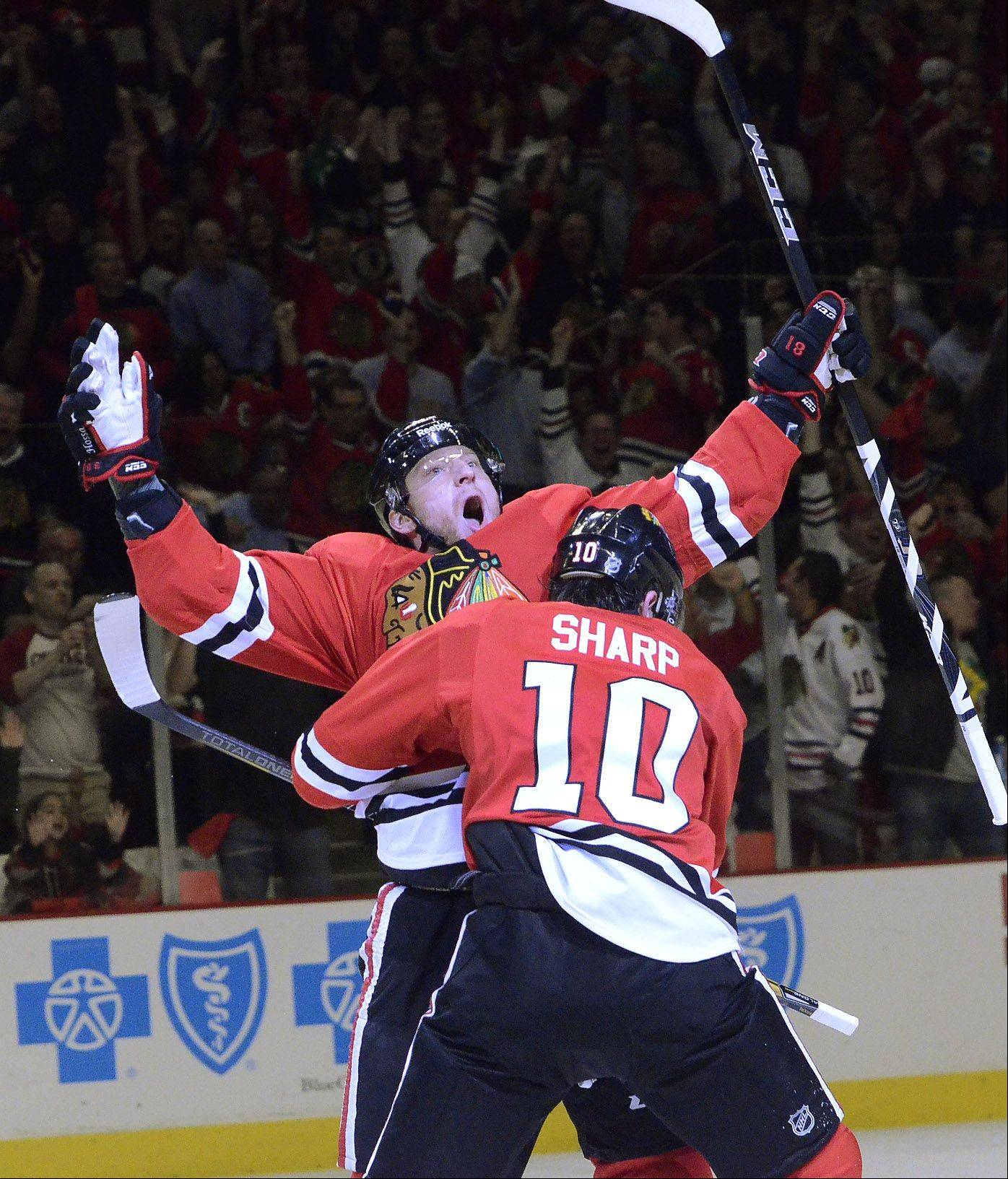 Marian Hossa celebrates after scoring on a power play in first period action.