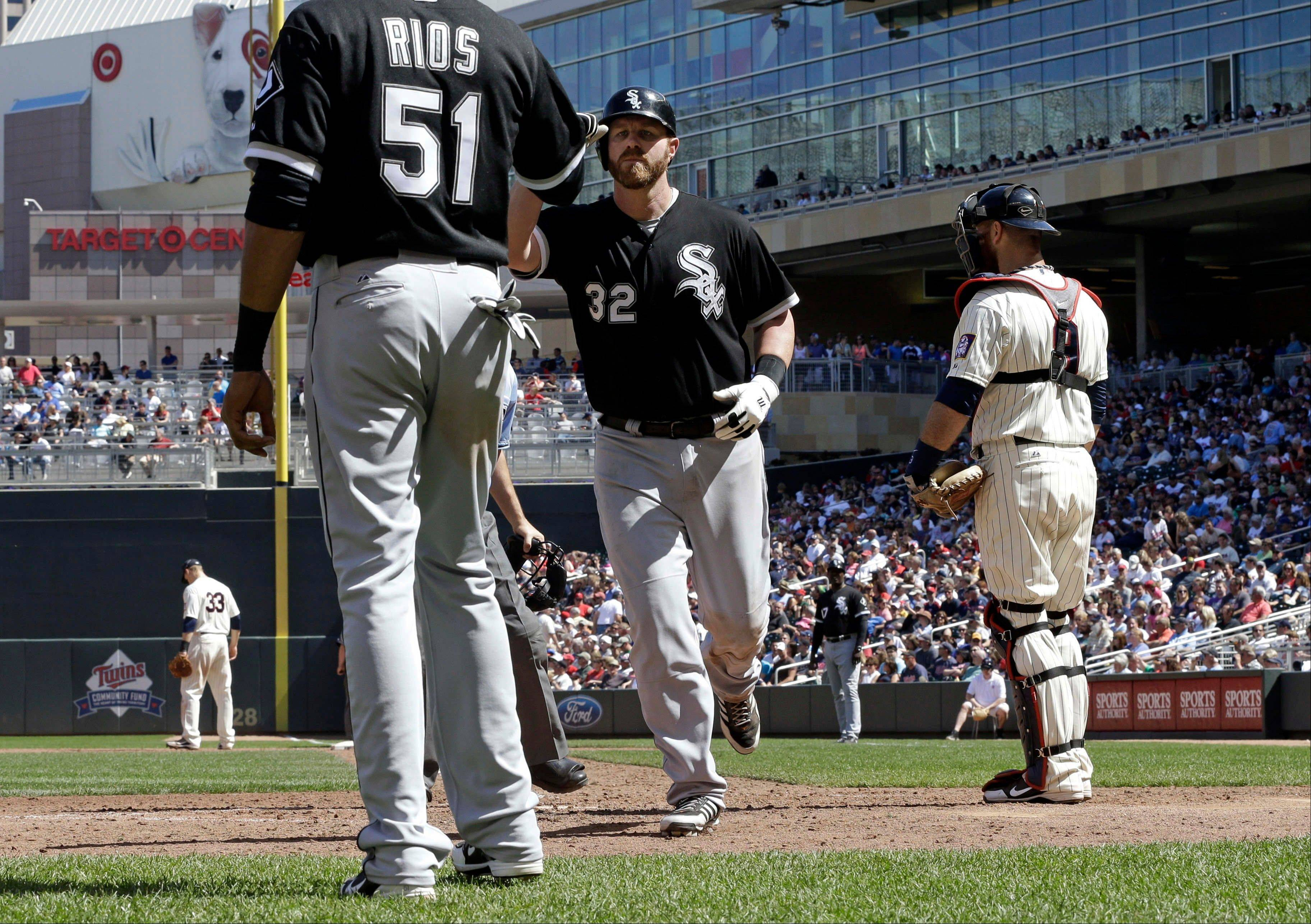 Chicago White Sox� Adam Dunn (32) is greeted by teammate Alex Rios after hitting his second two-run home run Wednesday against the Minnesota Twins in Minneapolis. The White Sox won 9-4.