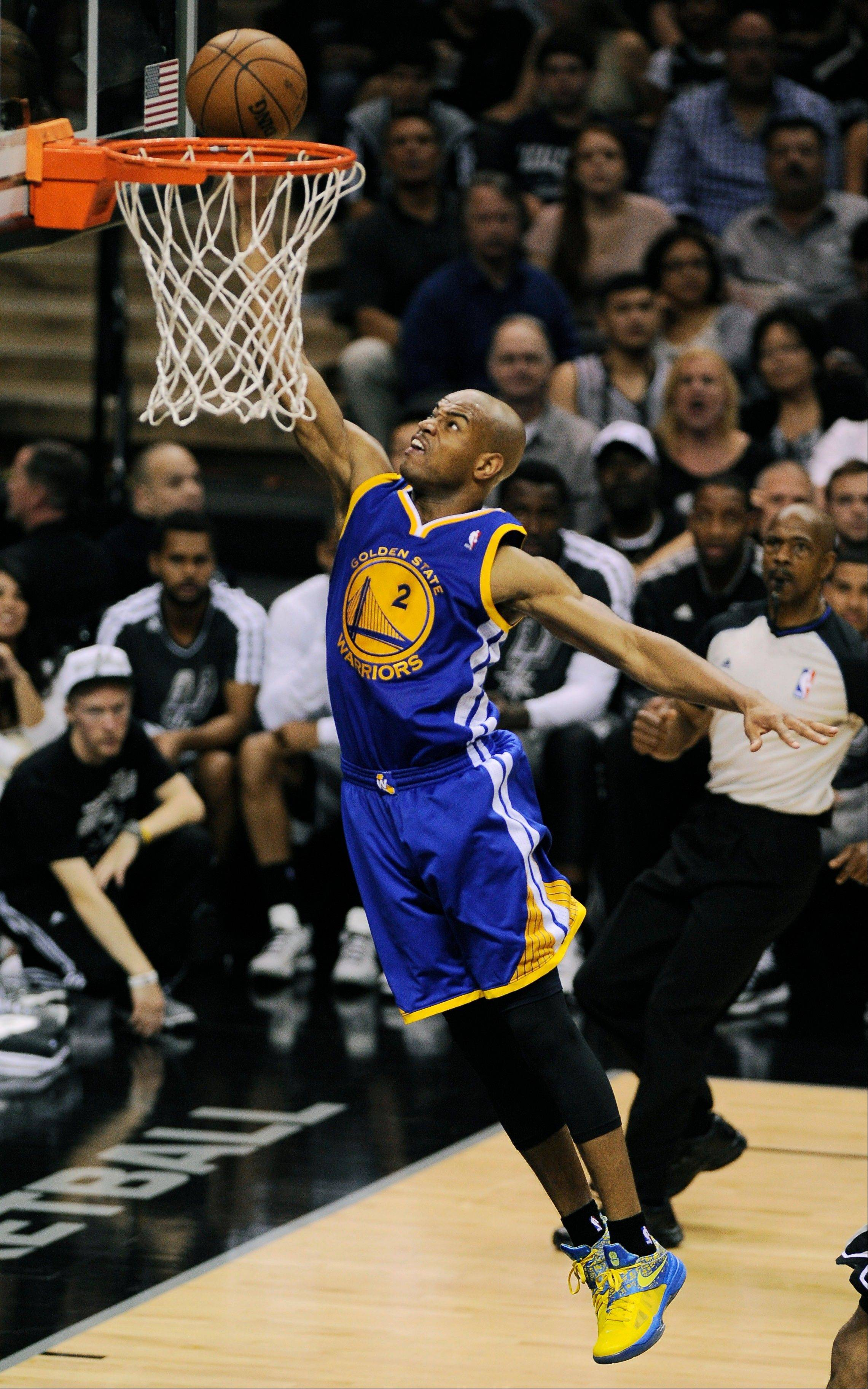 Golden State Warriors' Jarrett Jack shoots against the San Antonio Spurs during the second half of Game 5 of the Western Conference semifinal NBA basketball playoff series, Tuesday, May 14, 2013, in San Antonio. (AP Photo/Darren Abate)