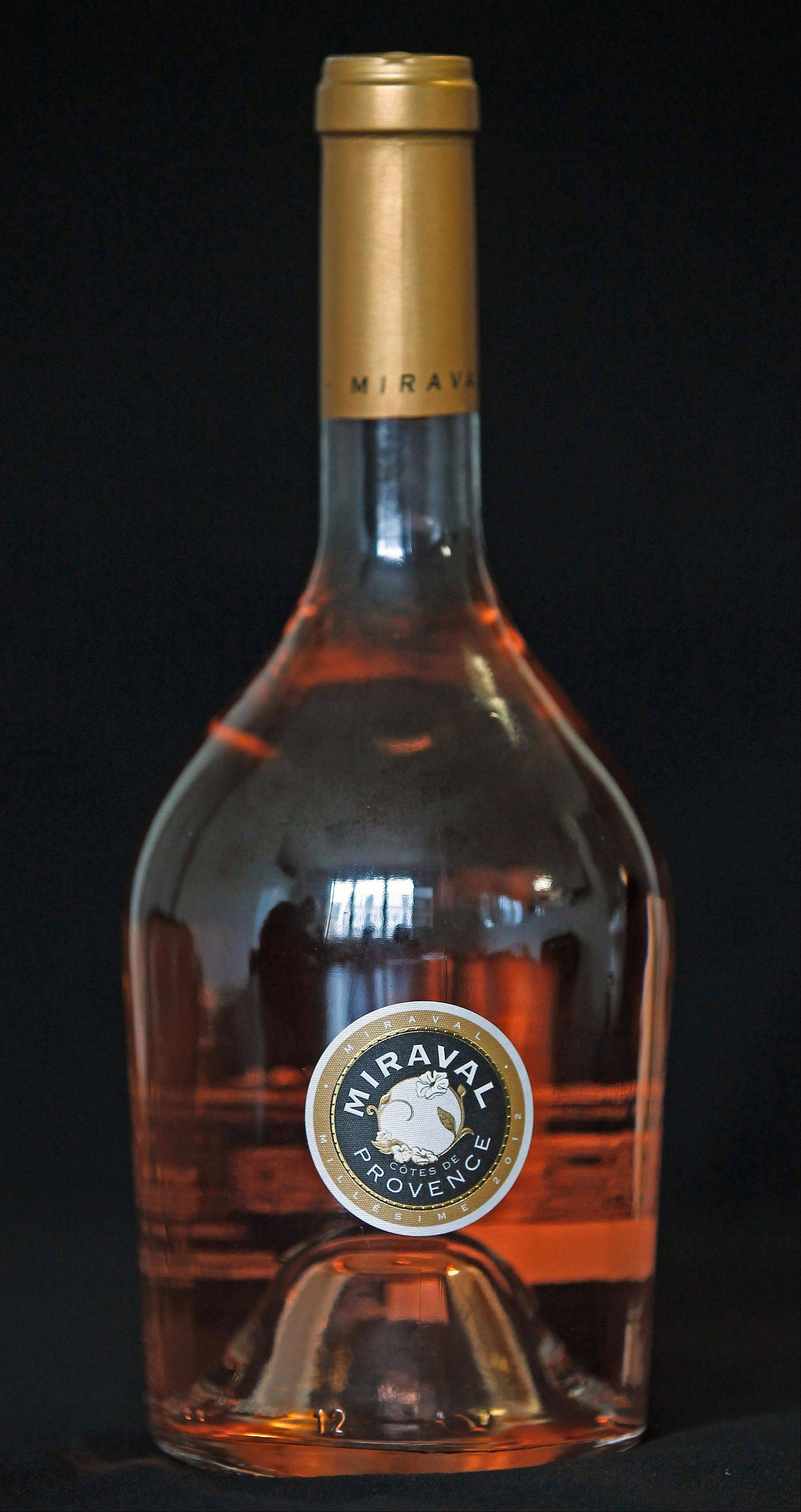 @Cation credit:Associated Press File PhotoAngelina Jolie and Brad Pitt partnered with the Perrin French winemaking family to come up with Miraval. Grapes for the wine are grown on the celebrity couple's land in the south of France.