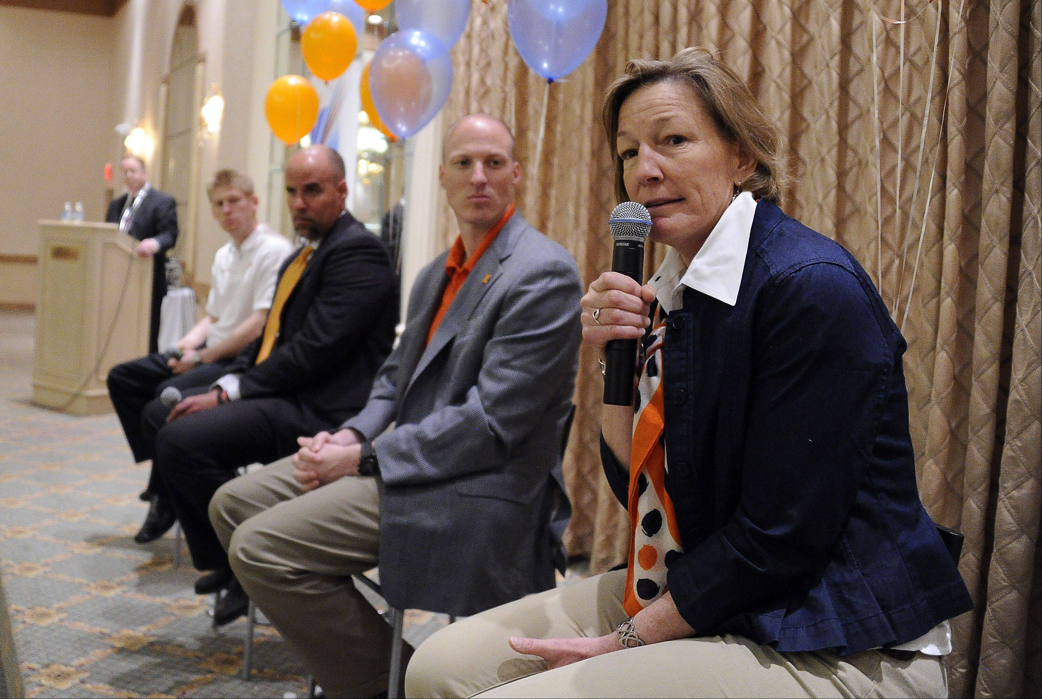 University of Illinois women's soccer coach Janet Rayfield answers questions from the audience at the Illini Caravan event Wednesday in Rolling Meadows.