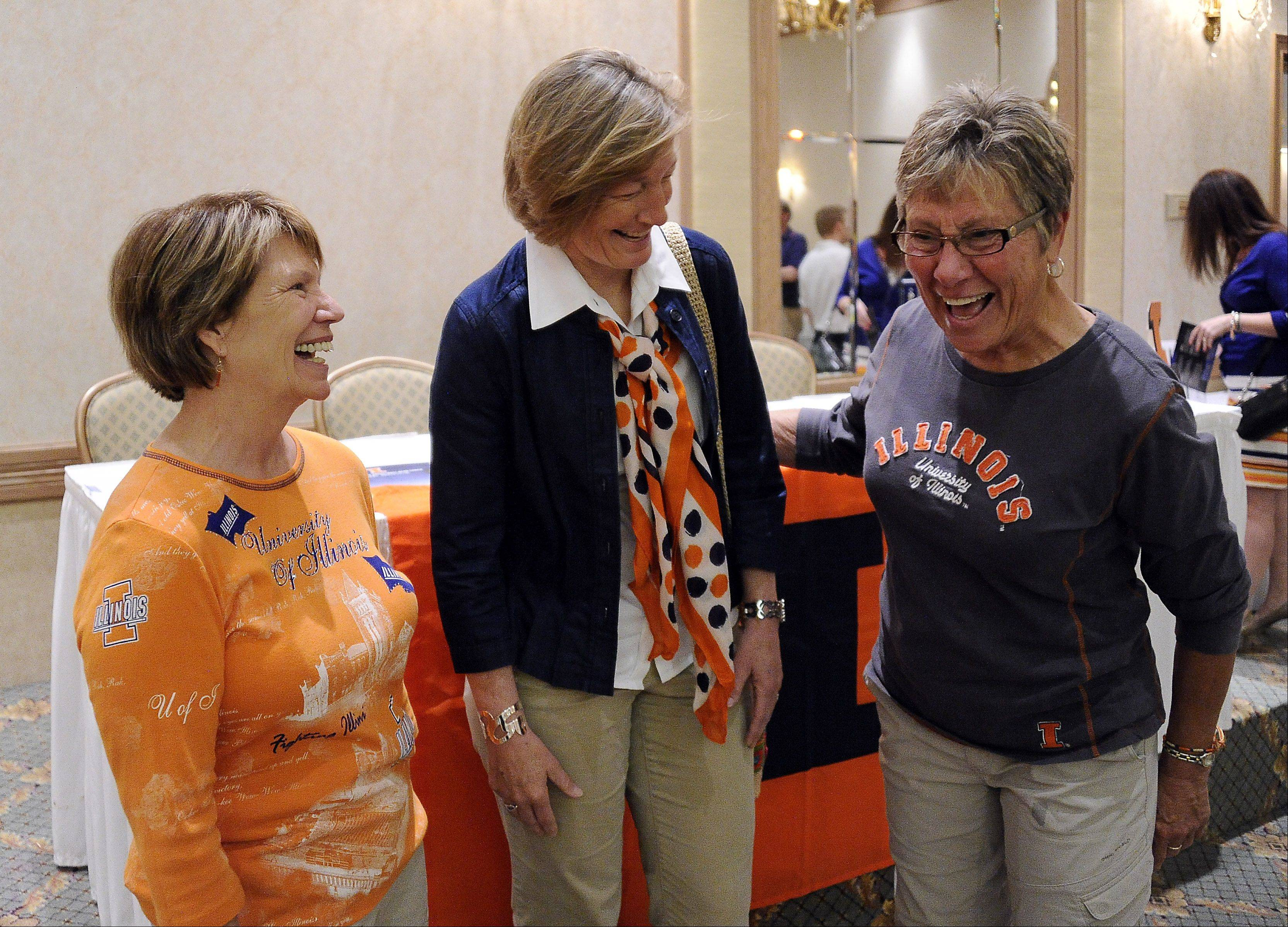 Illinois women's soccer coach Janet Rayfield talks with Hilary Carlson, left, of Bloomingdale, and Cheryl Wittler, right, of Wheaton, at the Illini Caravan event Wednesday in Rolling Meadows.