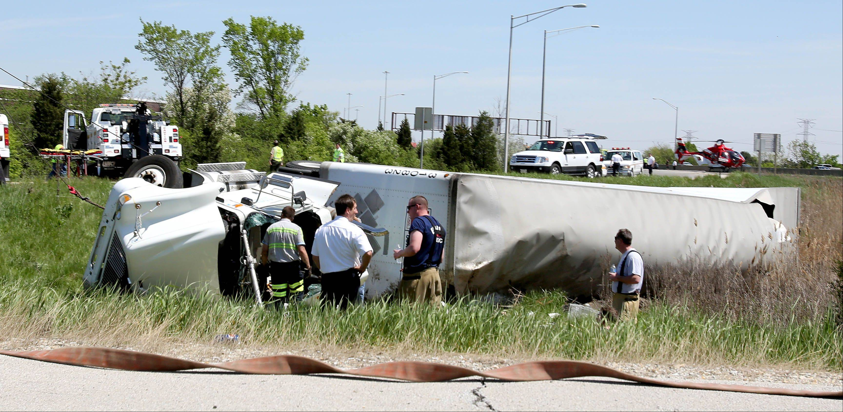 The westbound lanes of I-290 were closed Wednesday afternoon near the Bensenville-Elmhurst border after a semitrailer truck overturned on an exit ramp and the driver was trapped inside the cab.