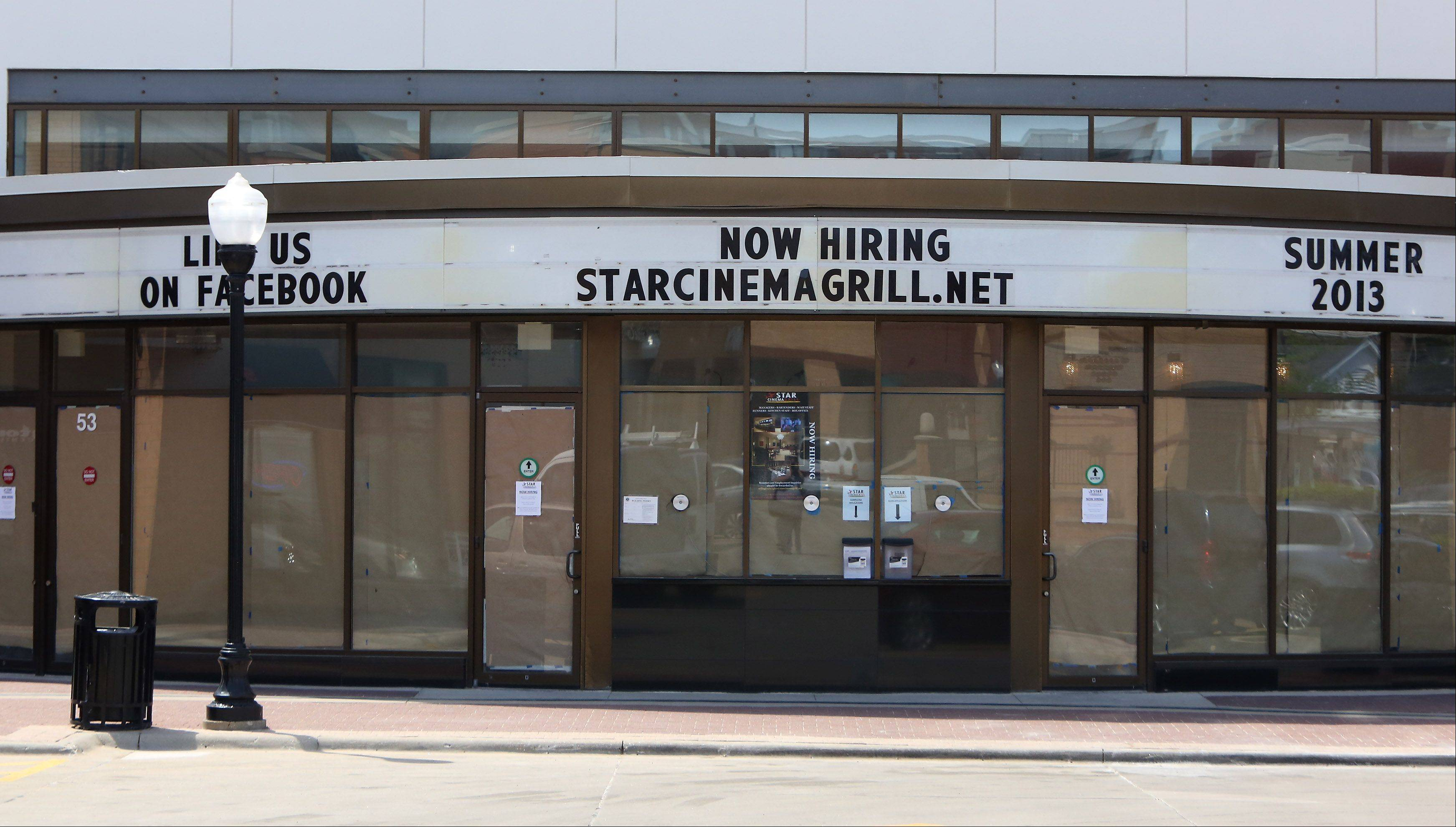 Workers are putting the finishing touches on the new Star Cinema Grill, which is scheduled to open in June in downtown Arlington Heights.