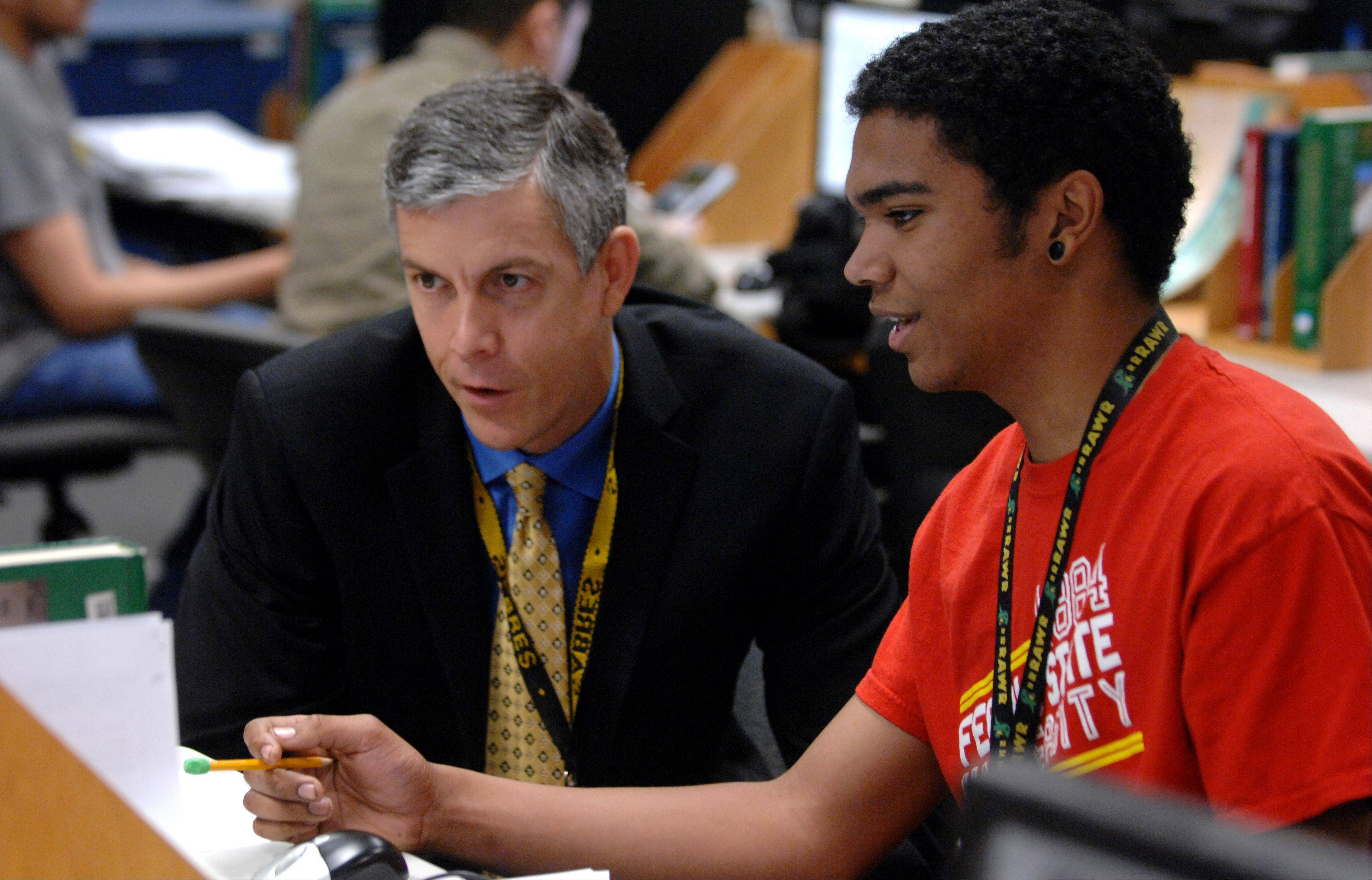 U.S. Secretary of Education Arne Duncan talks with Streamwood High School senior Jerell Fingers about his project in his principles of engineering class Wednesday.