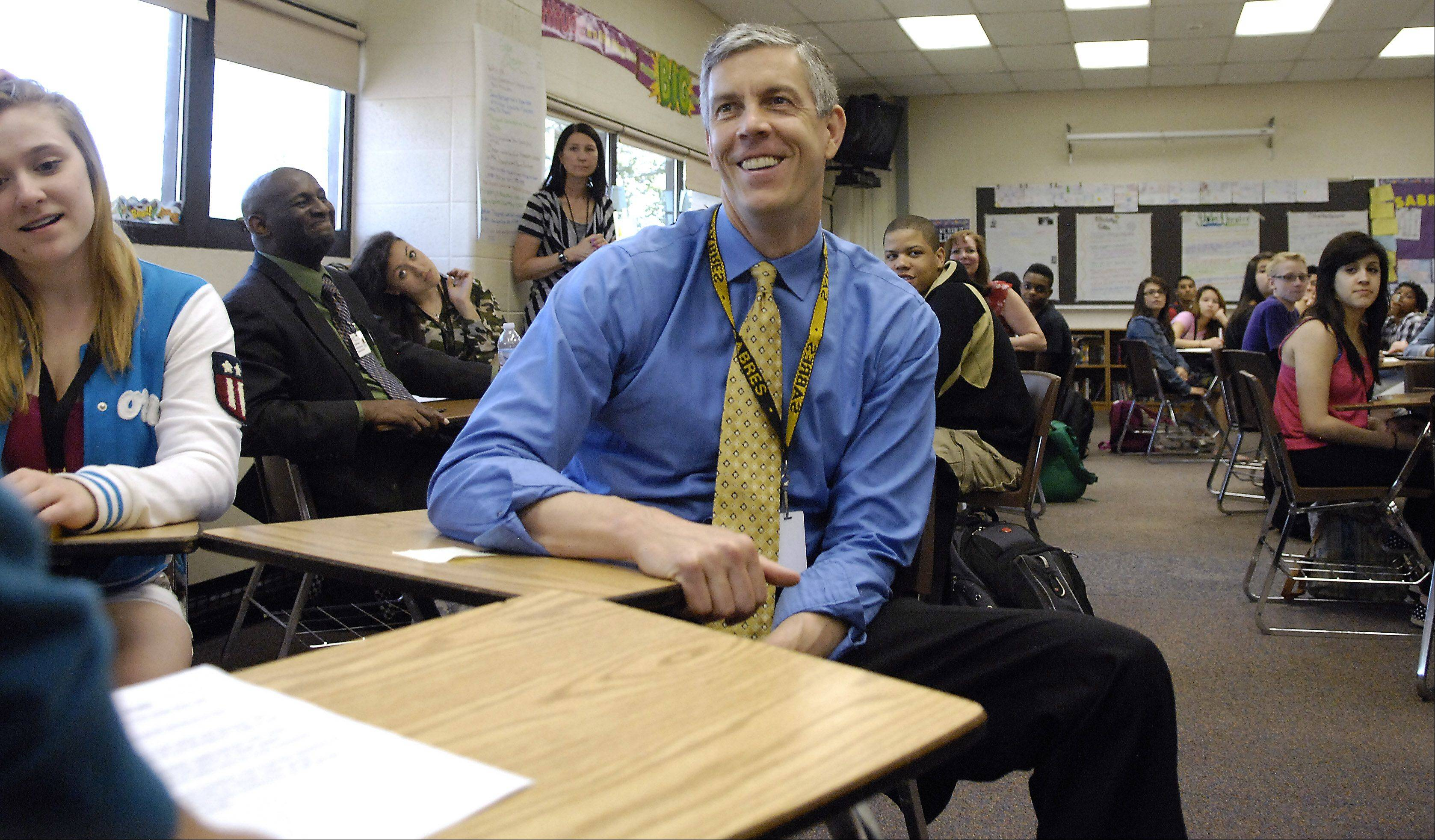 U.S. Secretary of Education Arne Duncan sits in on a reading intervention class during a visit to Streamwood High School Wednesday.
