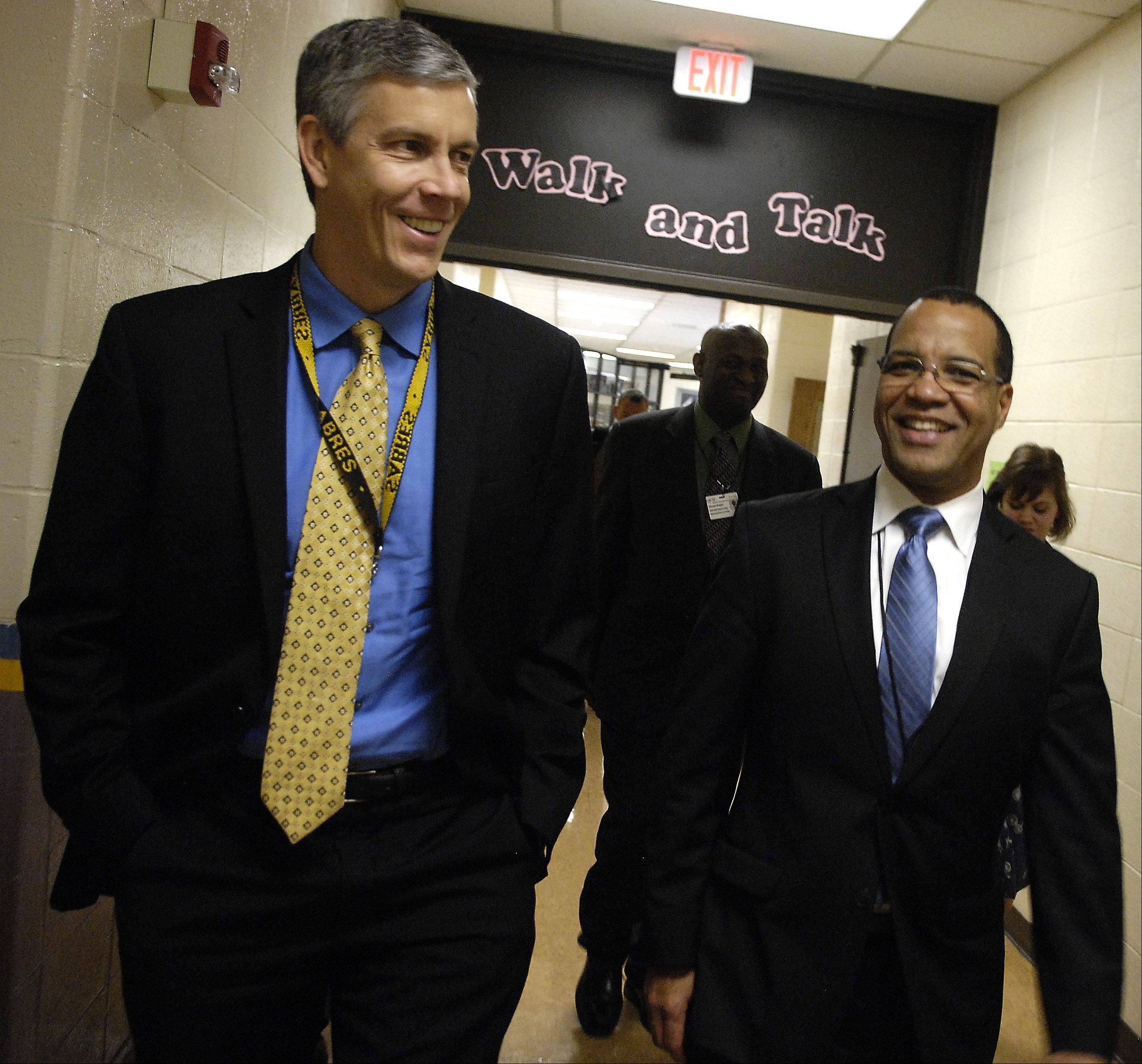 U.S. Secretary of Education Arne Duncan walks with Elgin Area School District U-46 Superintendent Jose Torres during a visit to Streamwood High School Wednesday.