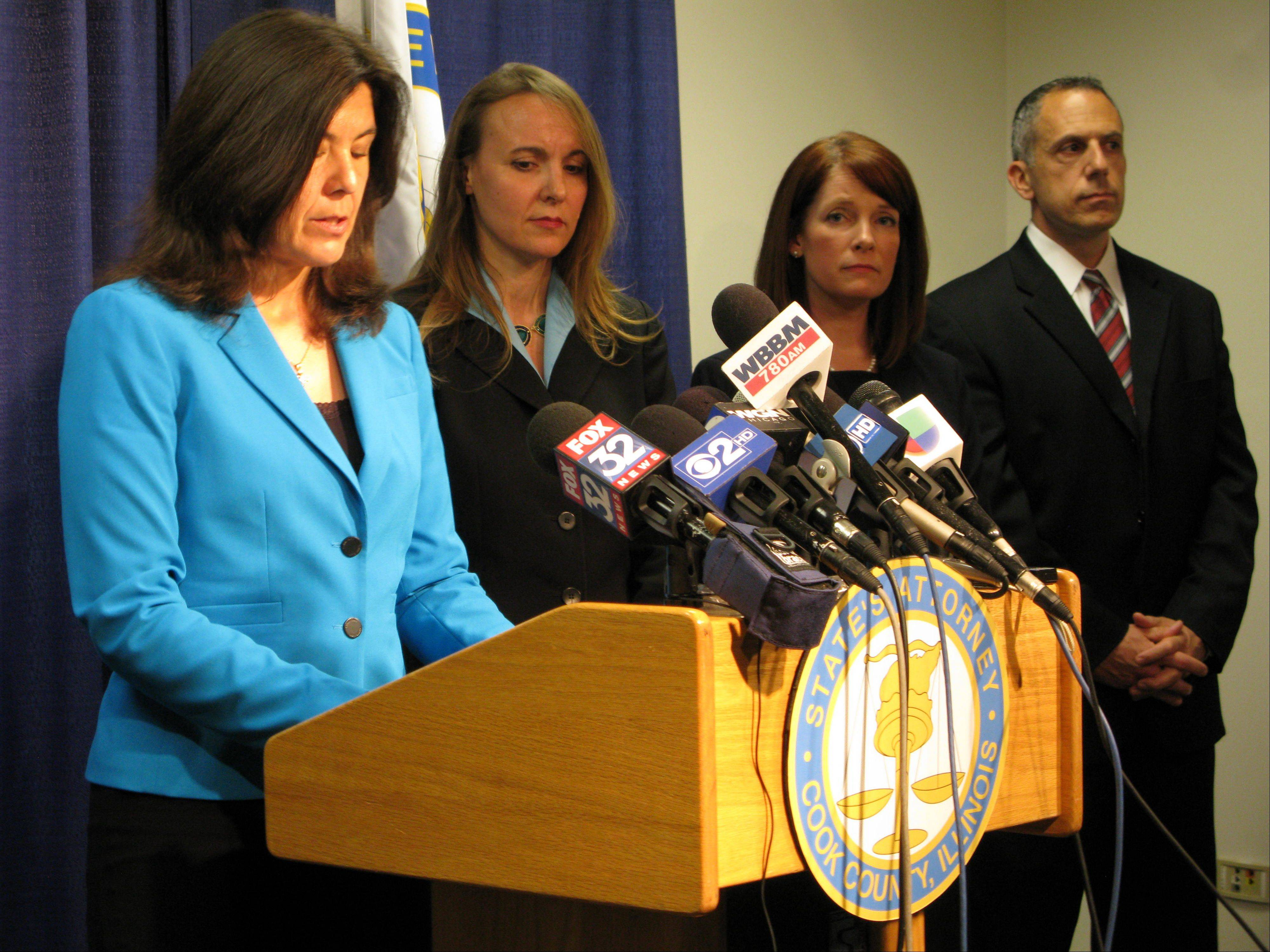 Cook County State's Attorney Anita Alvarez, left, announces multiple misdemeanor charges Wednesday against former Maine West High School soccer coach Michael Divincenzo related to hazing, battery and failure to report abuse, after her office's five-month-long investigation into allegations of hazing at the Des Plaines school.
