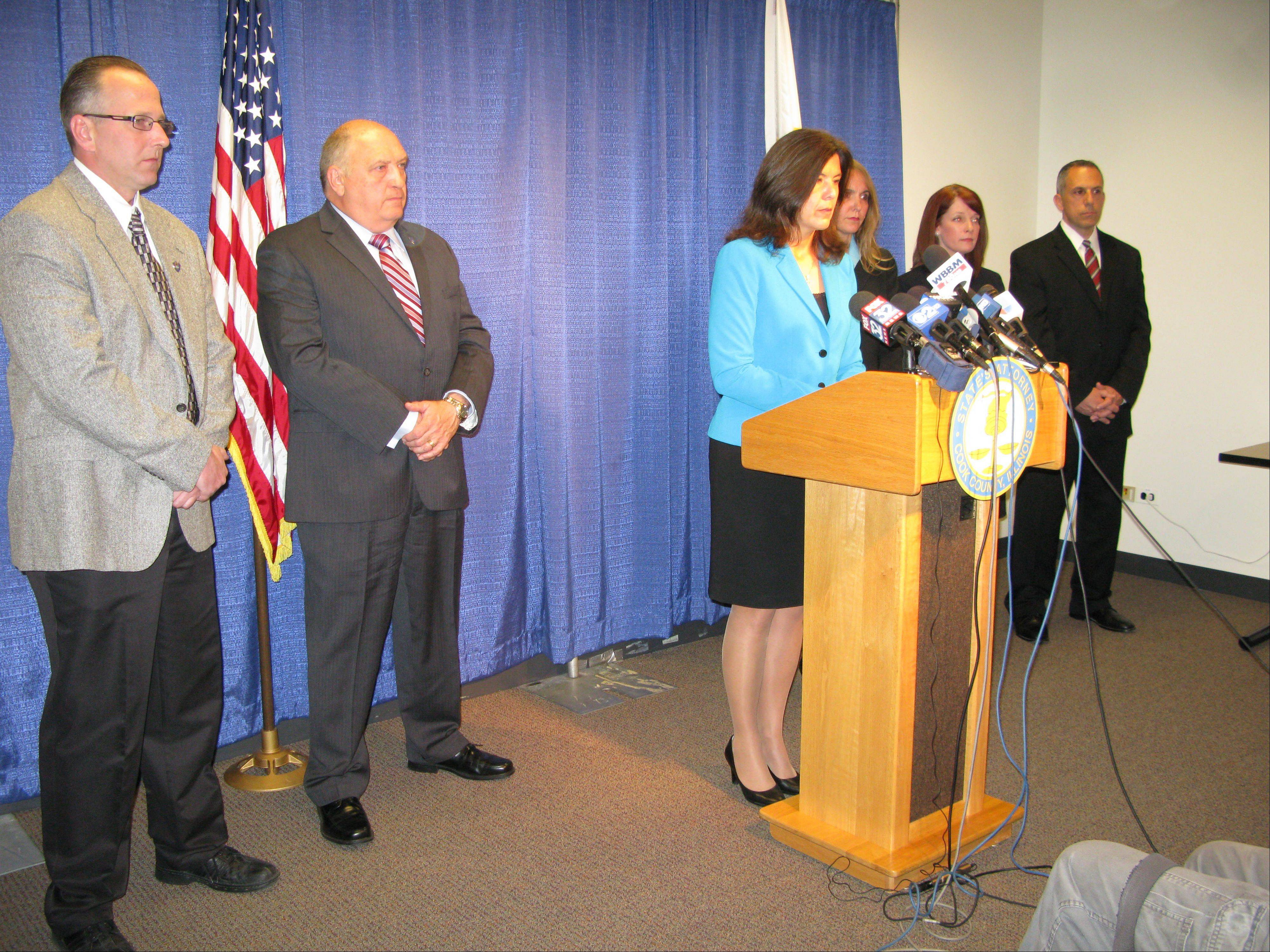 Cook County State's Attorney Anita Alvarez, at podium, announces multiple misdemeanor charges Wednesday against former Maine West High School soccer coach Michael Divincenzo related to hazing, battery and failure to report abuse, after her office's five-month-long investigation into allegations of hazing at the Des Plaines school.