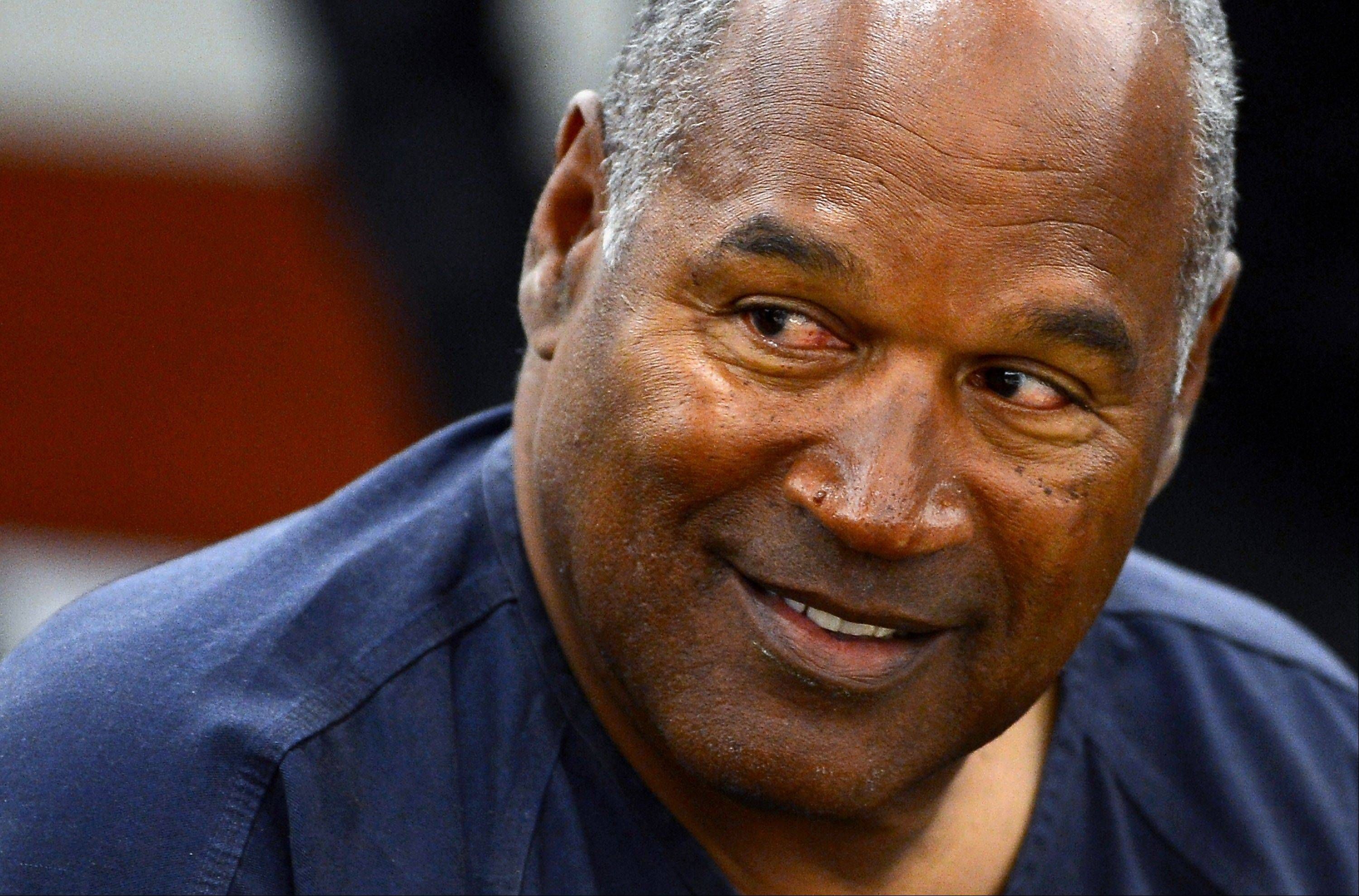 O.J. Simpson appears for the second day of an evidentiary hearing in Clark County District Court, Tuesday, May 14, 2013 in Las Vegas. The hearing is aimed at proving Simpson's trial lawyer, Yale Galanter, had conflicted interests and shouldn't have handled Simpson's case. Simpson is serving nine to 33 years in prison for his 2008 conviction in the armed robbery of two sports memorabilia dealers in a Las Vegas hotel room.
