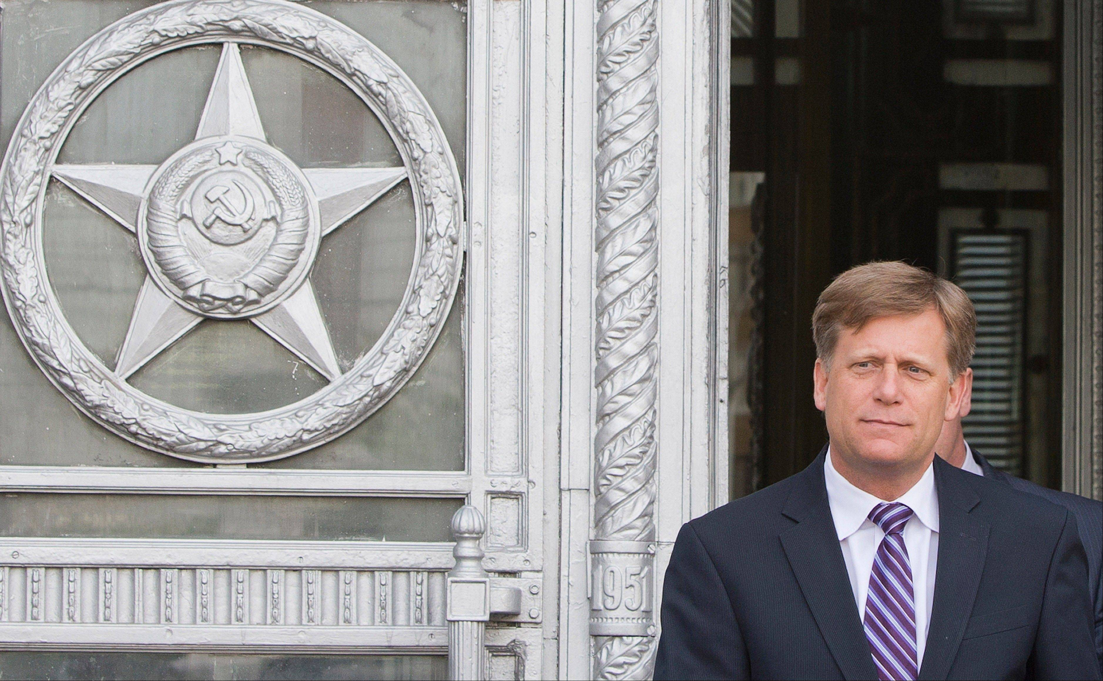 The U.S. Ambassador to Russia Michael McFaul leaves Foreign Ministry headquarters in Moscow, Russia, Wednesday, May 15, 2013. McFaul was summoned by the Russian foreign ministry in connection with an alleged spy detention in Moscow. He entered the ministry's building in central Moscow Wednesday morning and left half an hour later without saying a word to journalists waiting outside the compound.