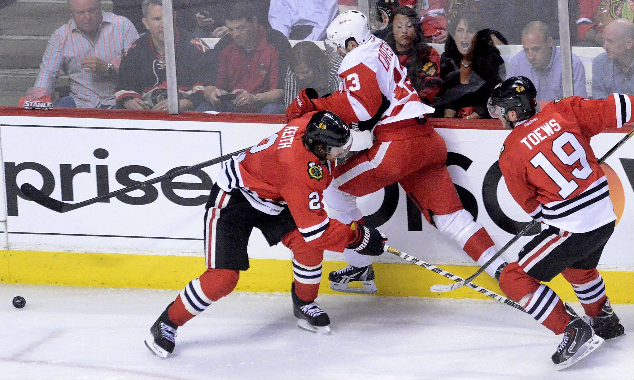 Detroit's Pavel Datsyuk gets sandwiched between Duncan Keith and Jonathan Toews in first-period action of Game 1 of the Western Conference semifinals between the Blackhawks and the Red Wings.