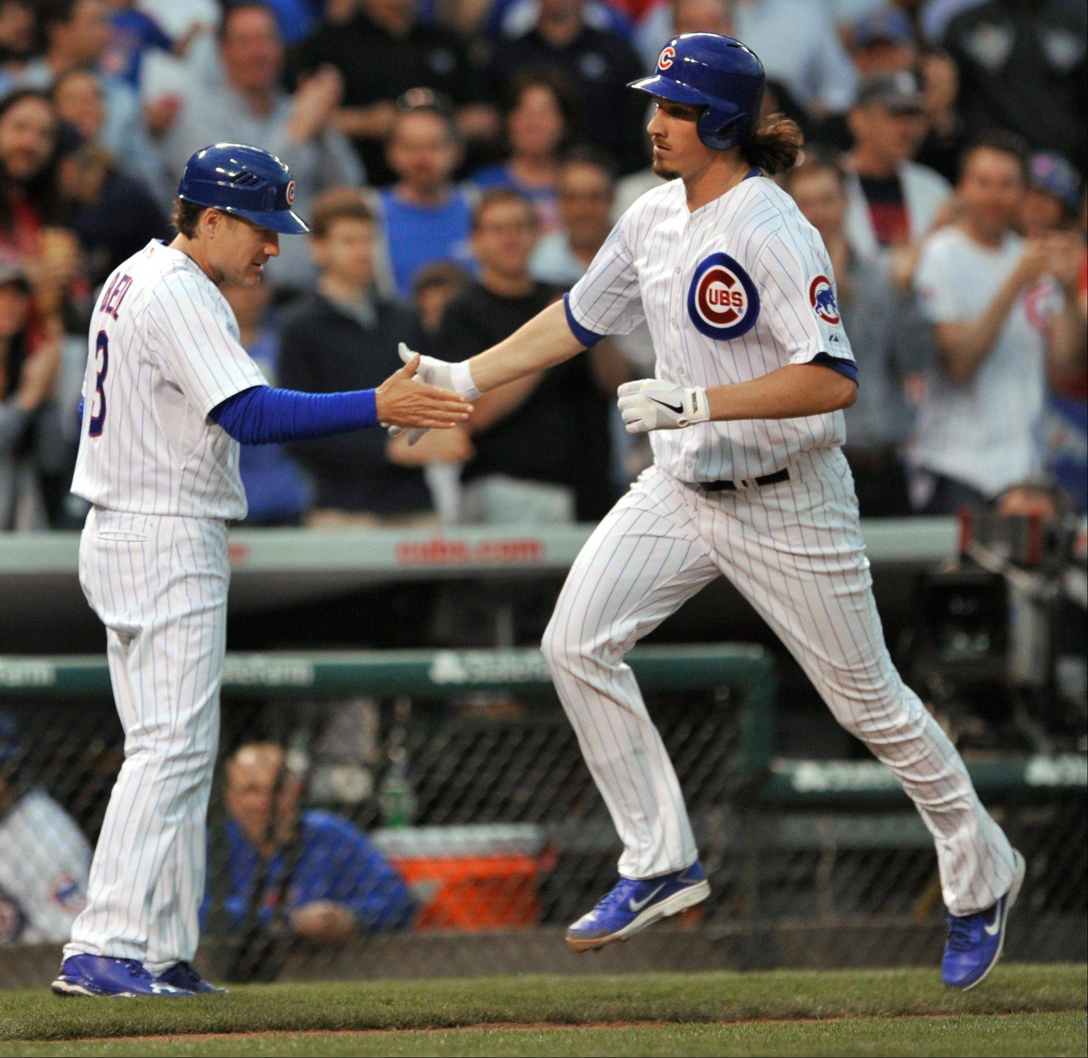 The Cubs' Jeff Samardzija, right, celebrates with third-base coach David Bell after hitting a 2-run home run during the second inning Wednesday night against the Colorado Rockies at Wrigley Field. The Cubs won 6-3.