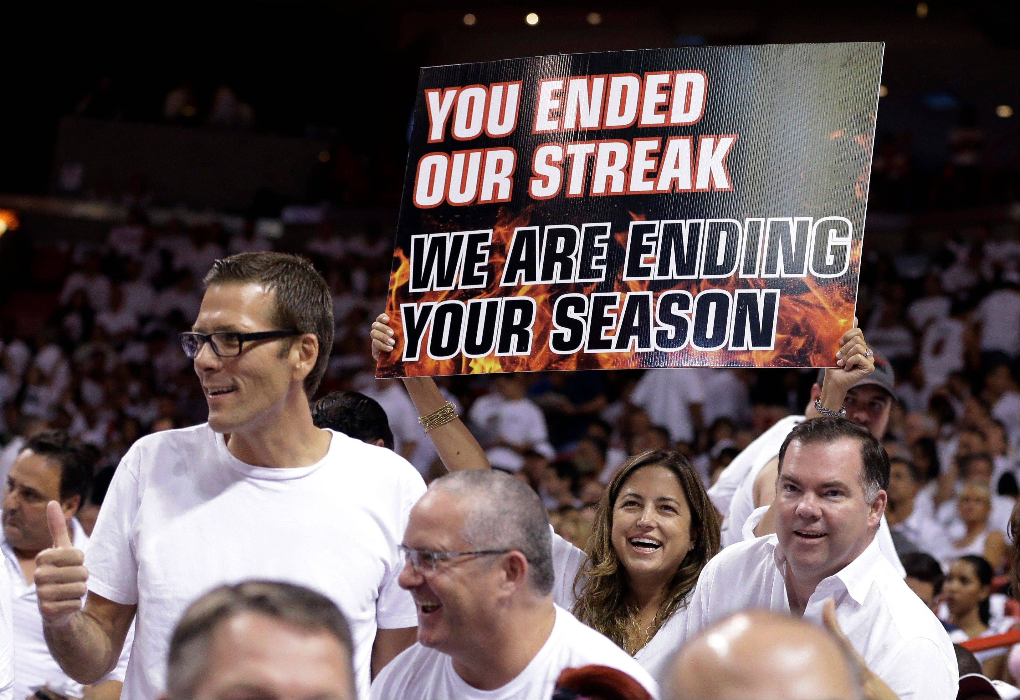 A Miami Heat fan holds up a sign during the first half of Game 5 of an NBA basketball Eastern Conference semifinal between the Heat and the Chicago Bulls, Wednesday, May 15, 2013 in Miami. The Heat defeated the Bulls 94-91, and advance to the conference finals.