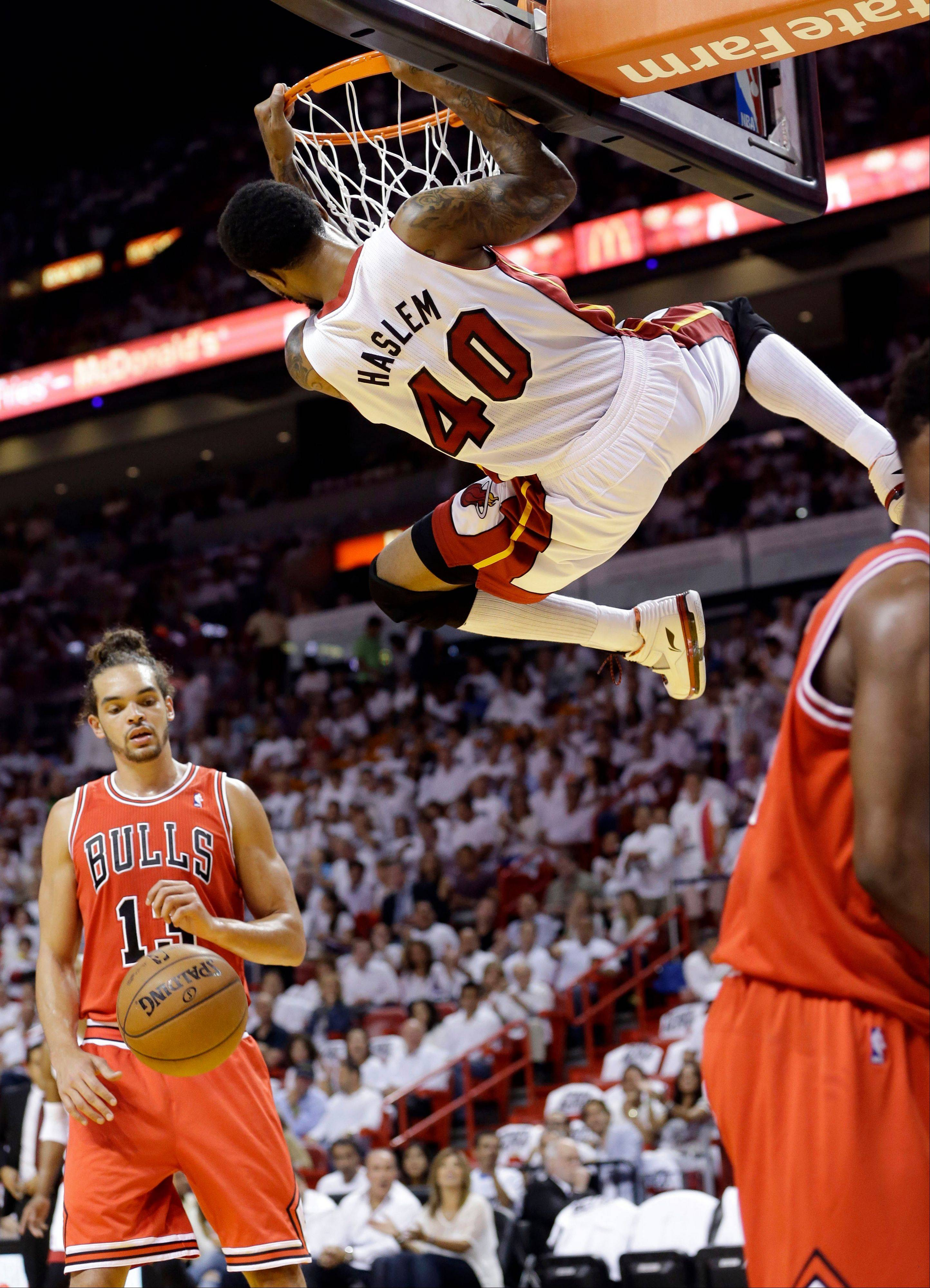 Miami Heat's Udonis Haslem (40) dunks in front of Chicago Bulls' Joakim Noah (13) during the first half of Game 5 of an NBA basketball Eastern Conference semifinal, Wednesday, May 15, 2013, in Miami.