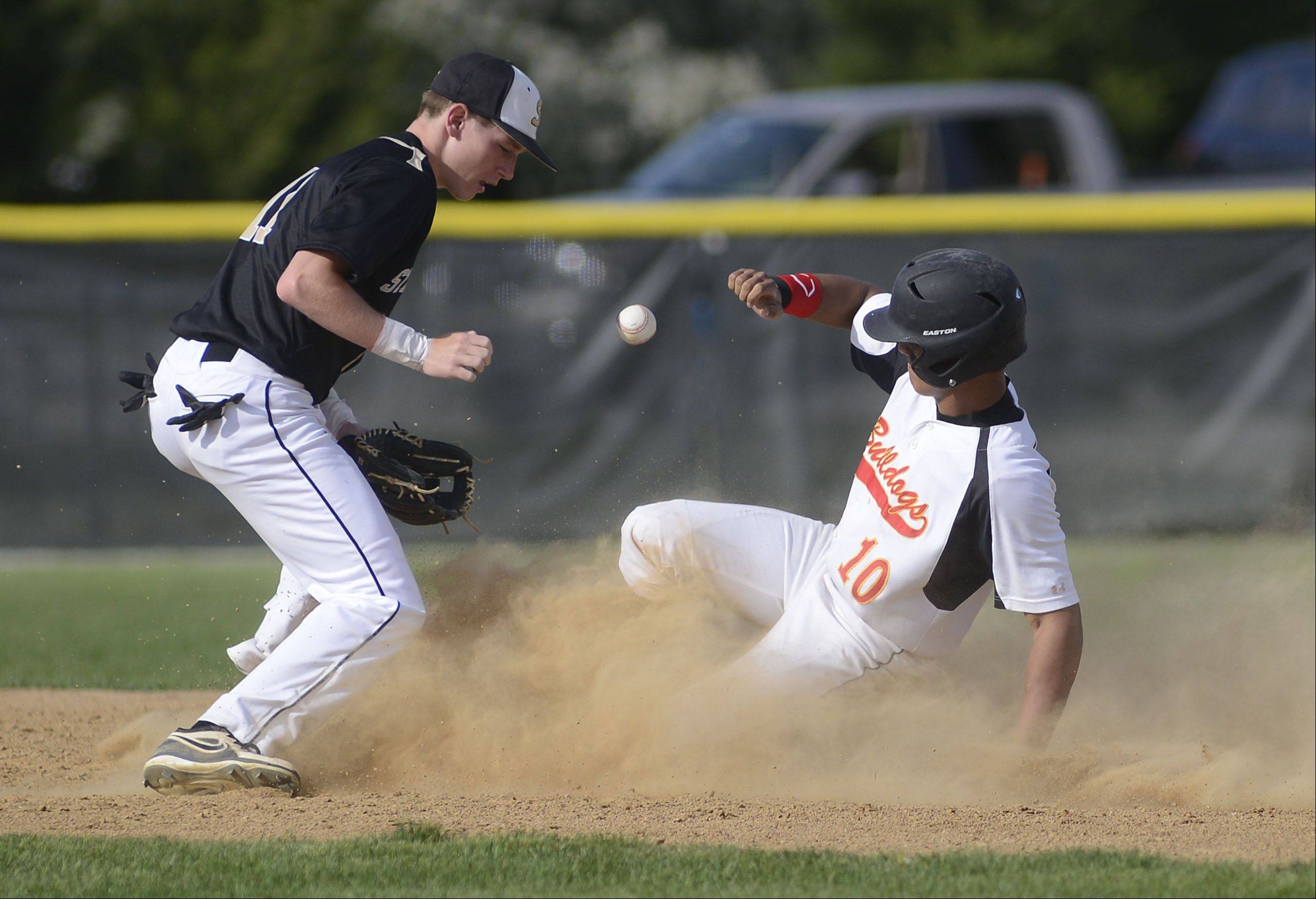 Batavia's Laren Eustace is safe on second base as the ball pops out of Streamwood's Michael Smith's glove in the first inning on Wednesday, May 15.