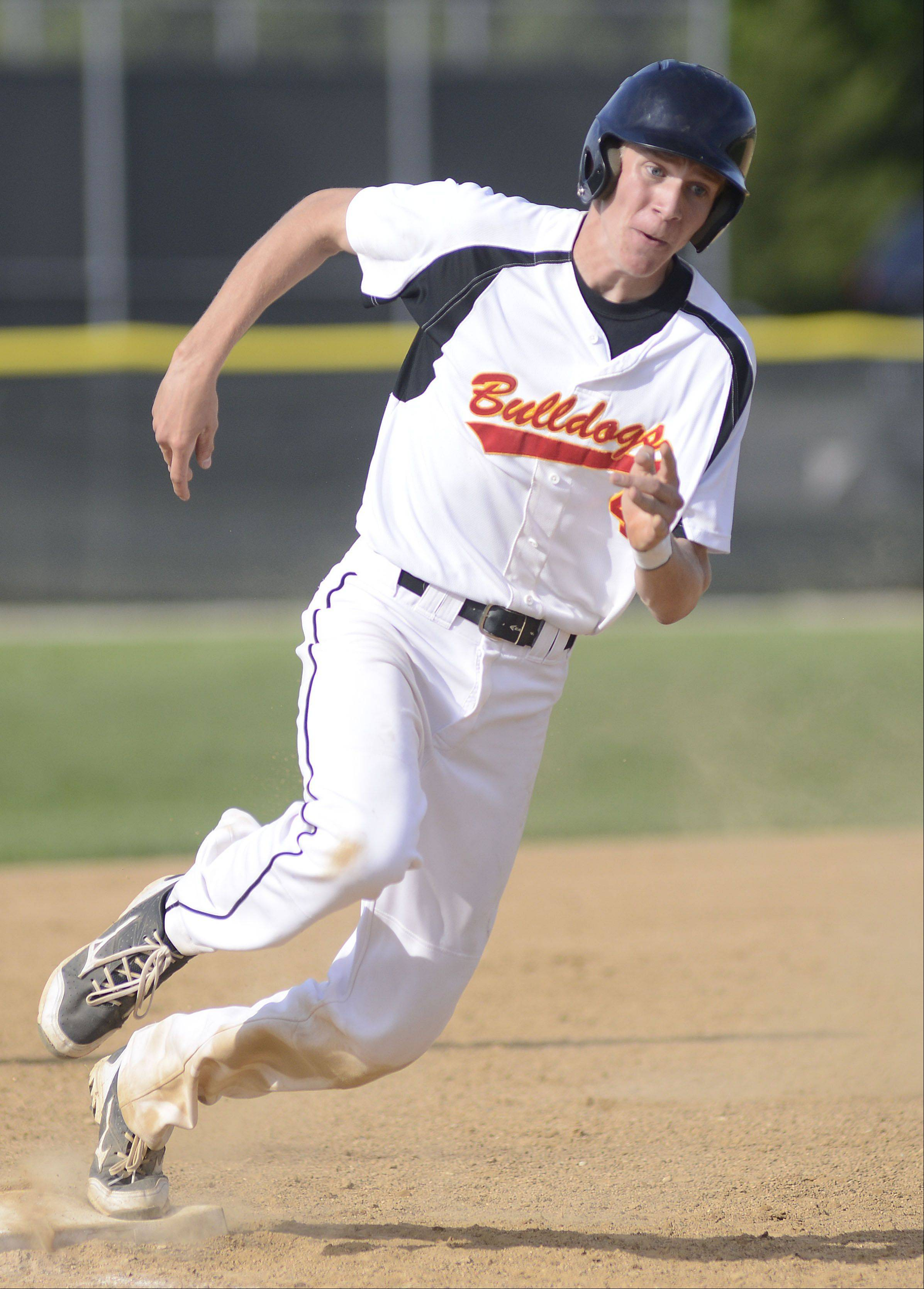 Batavia's Billy Zwick rounds third base heading for home plate in the first inning on Wednesday, May 15.