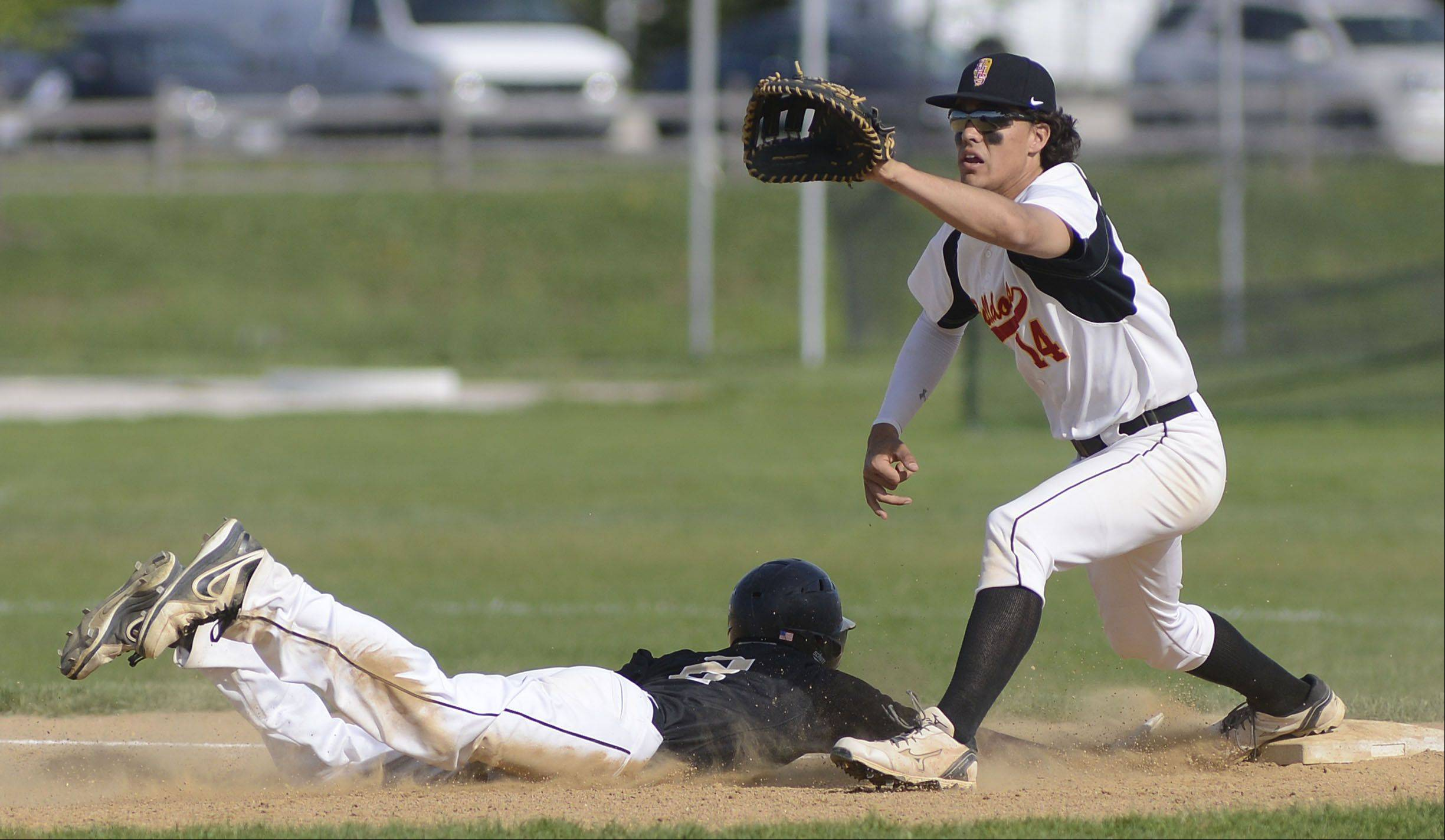 Streamwood's Matt Harding is safe back on first with a slide from Batavia's Micah Coffey in the first inning on Wednesday, May 15.