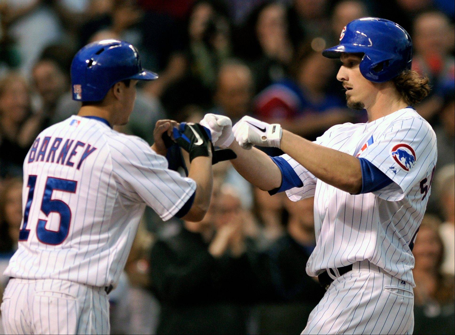 Chicago Cubs' Jeff Samardzija, right, celebrates with teammate Darwin Barney at home plate after hitting a two-run home run Wednesday at Wrigley Field. The Cubs beat the Colorado Rockies 6-3.