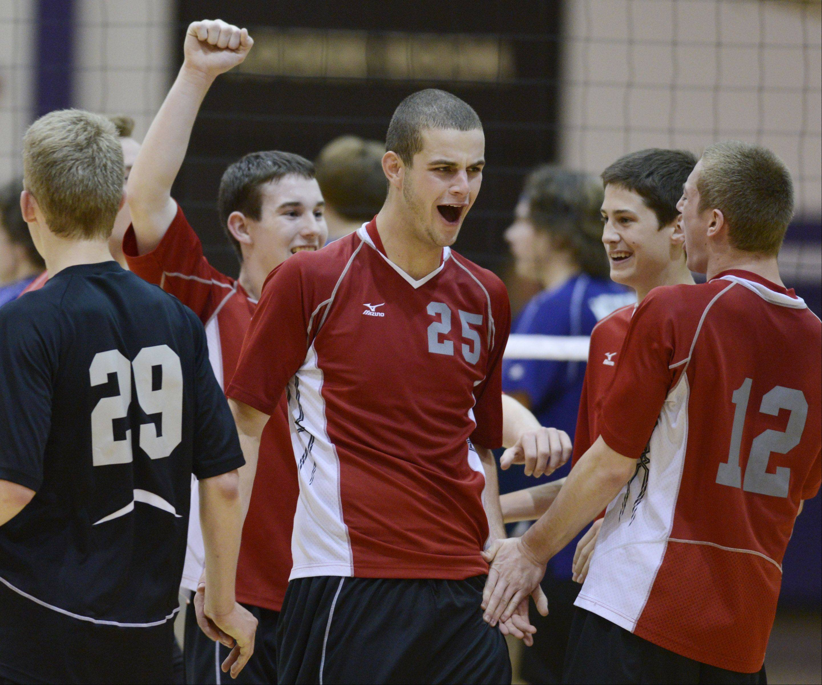Palatine's Brian Keough, middle, celebrates with his teammates after the Pirates won the Mid-Suburban League boys volleyball championship at Rolling Meadows on Wednesday.