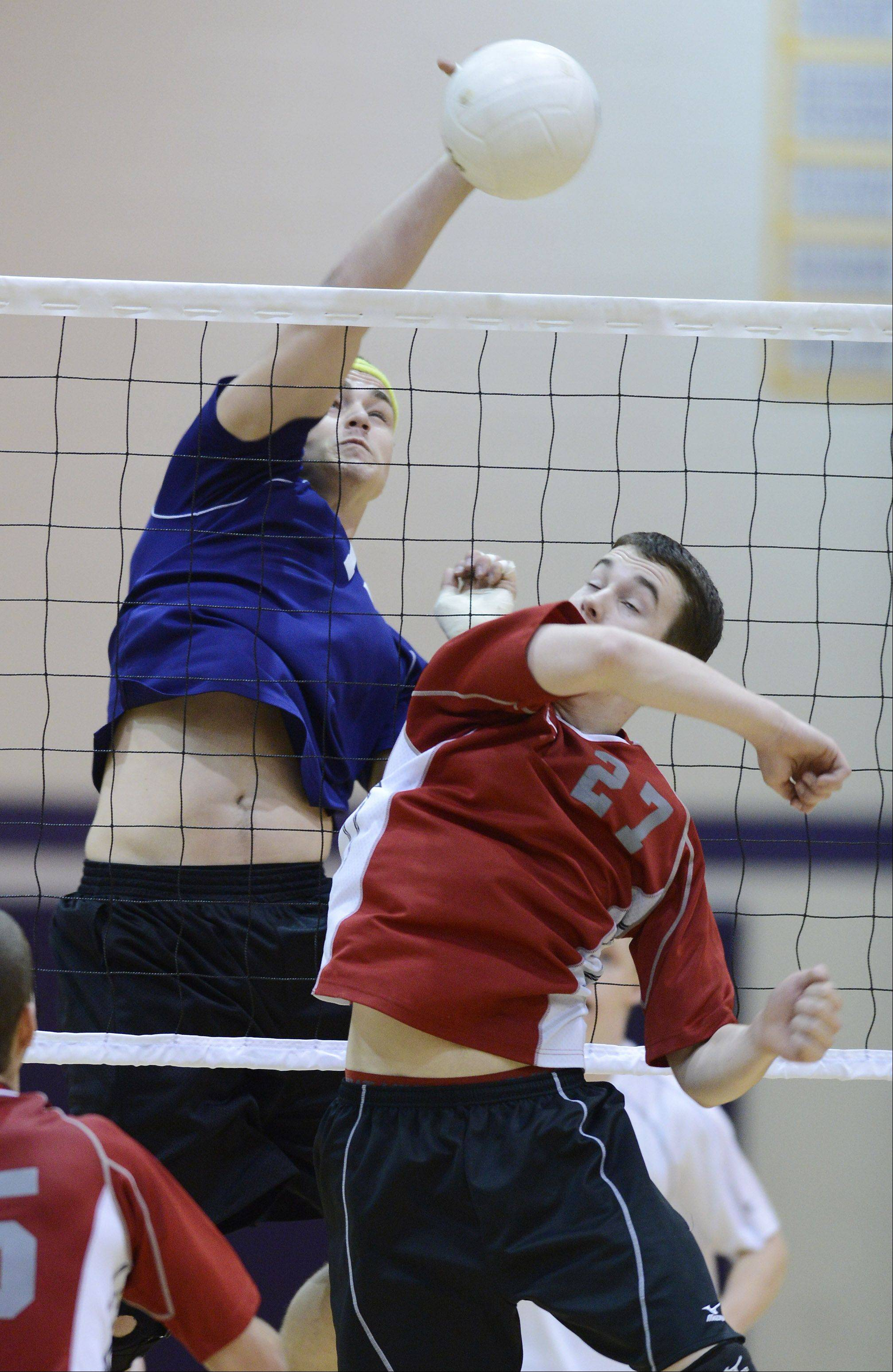 Rolling Meadows' David Sobkowicz looks for a kill as Palatine's Kyle Obernesser tries to get a hand on the ball during the Mid-Suburban League championship on Wednesday.