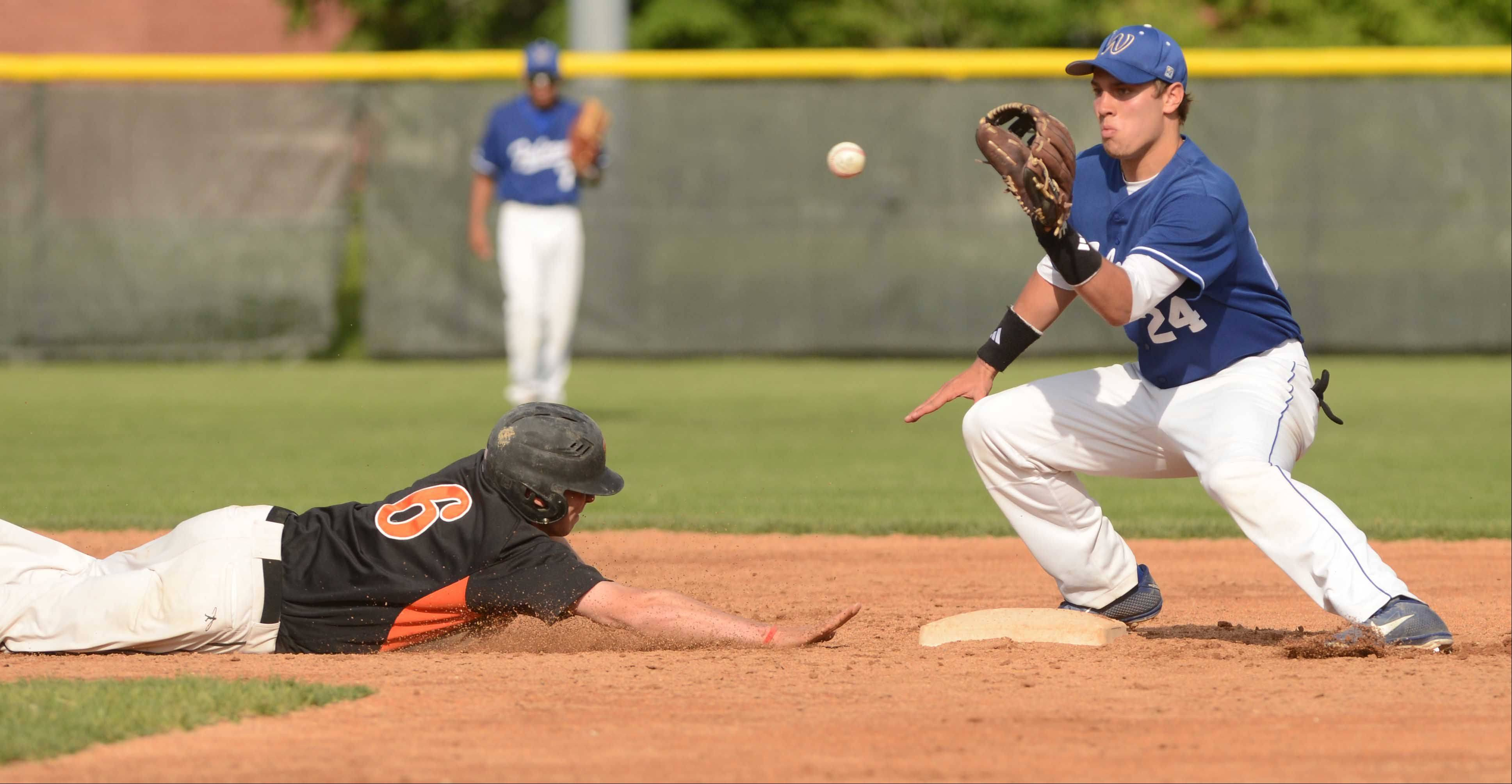 Ben Bach of Wheaton Warrenville South reaches for second while John Peltz of Wheaton North catches the ball. He was safe. This took place during the Wheaton Warrenville South vs. Wheaton North baseball game Wednesday.