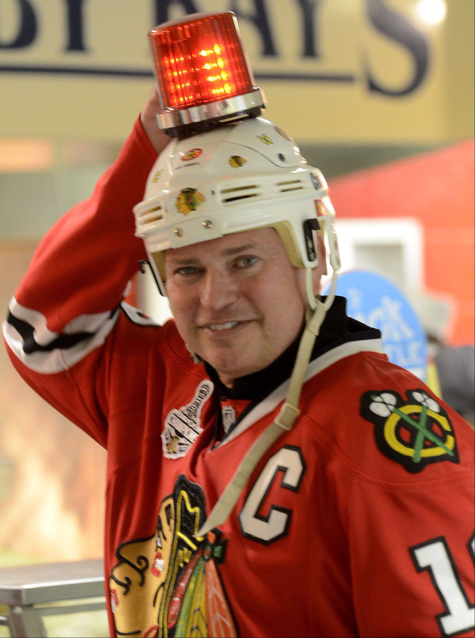 Rich Kiel of Chicago checks his goal lamp before Game 1 of the Western Conference semifinals between the Blackhawks and the Detroit Red Wings.
